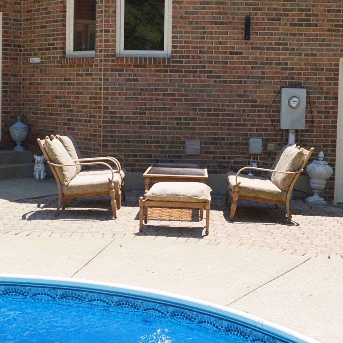 Hampton-Bay Patio Sofas, Coffee Table, and Ottomans