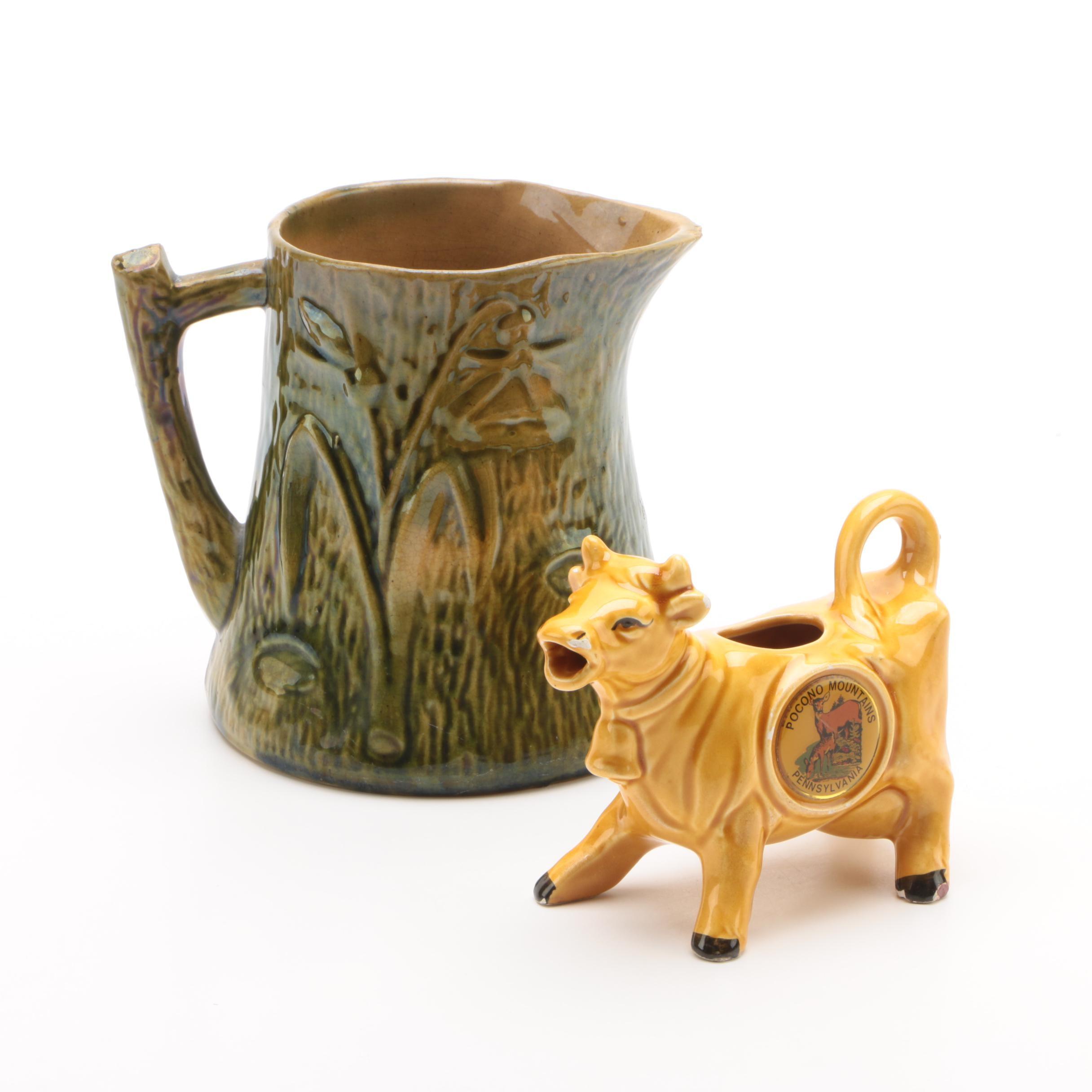Ceramic Pitchers Including Figural Cow Creamer