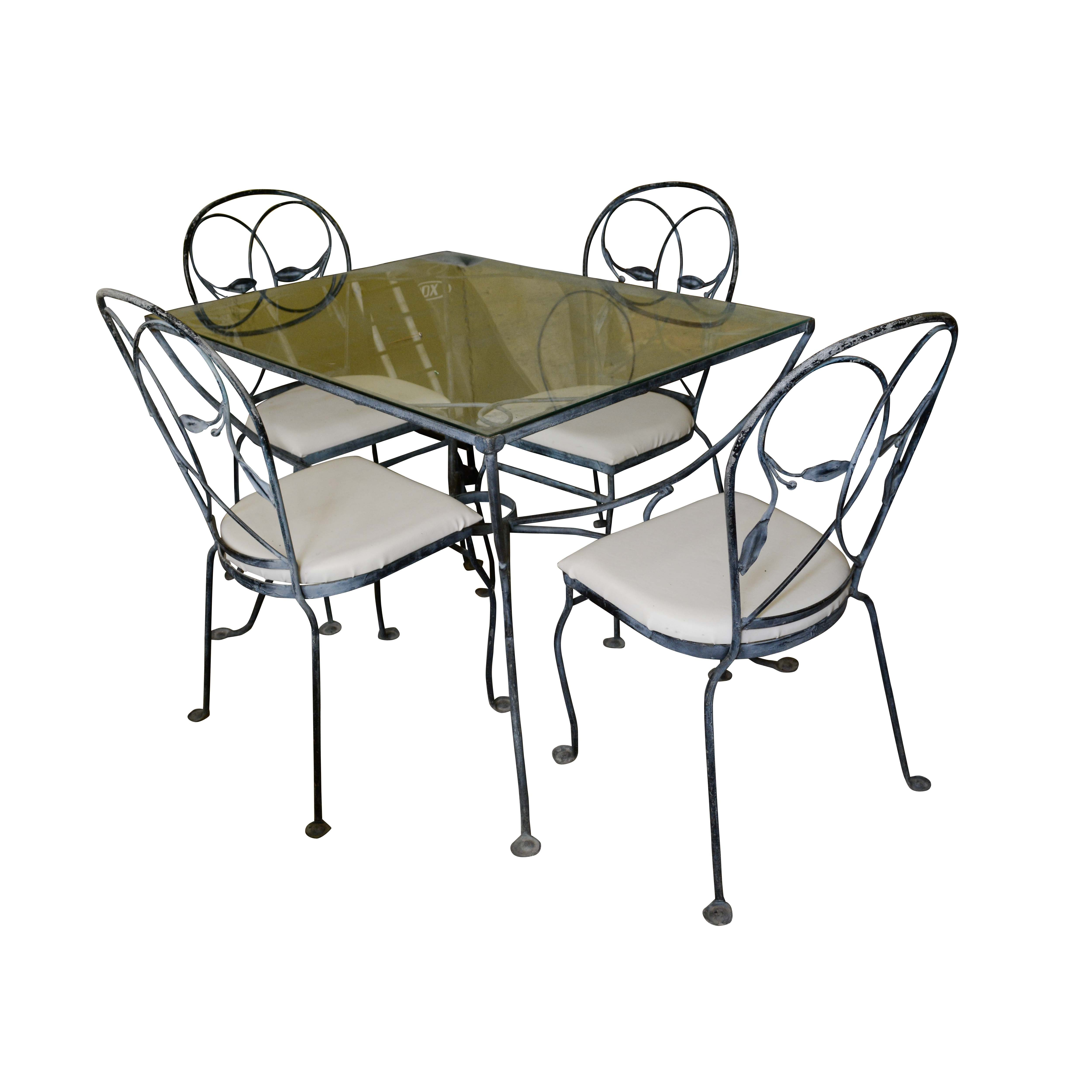 Glass and Metal Patio Table with Side Chairs