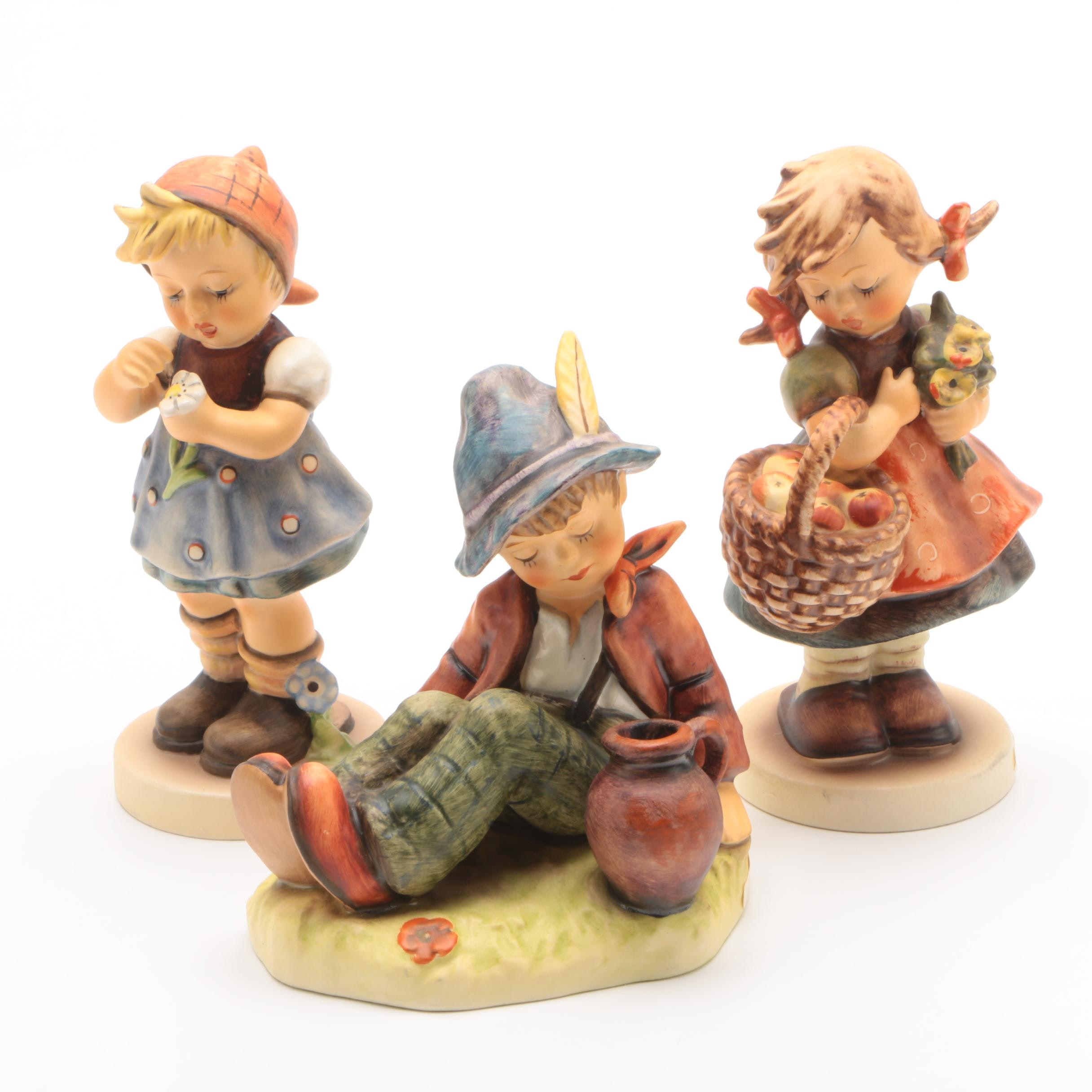 "Hummel Figurines, ""Daisies Don't Tell"", ""Coffee Break"" and ""Autumn Harvest"""