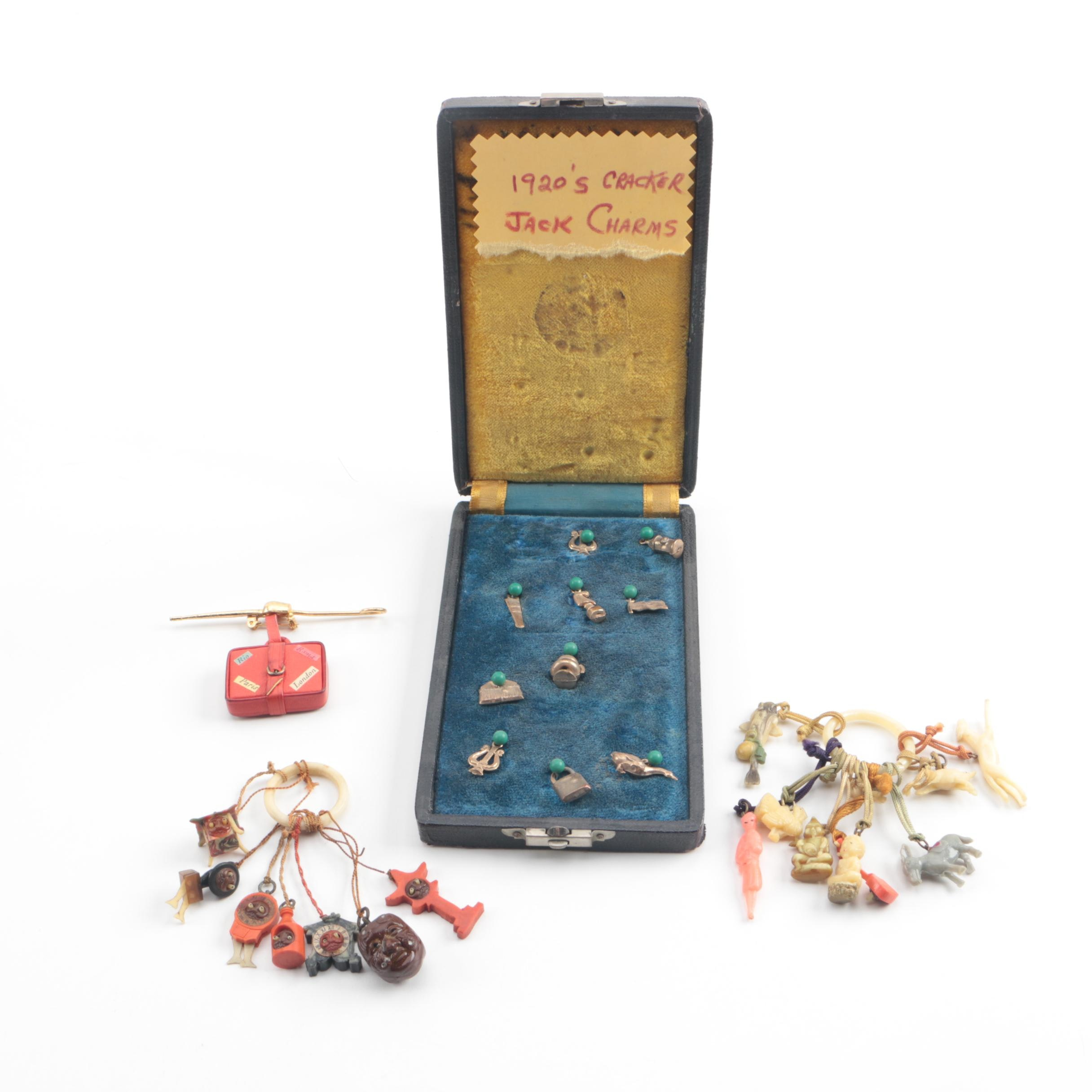 Vintage Early Plastic, Leather, and Metal Charms Including Cracker Jack Prizes