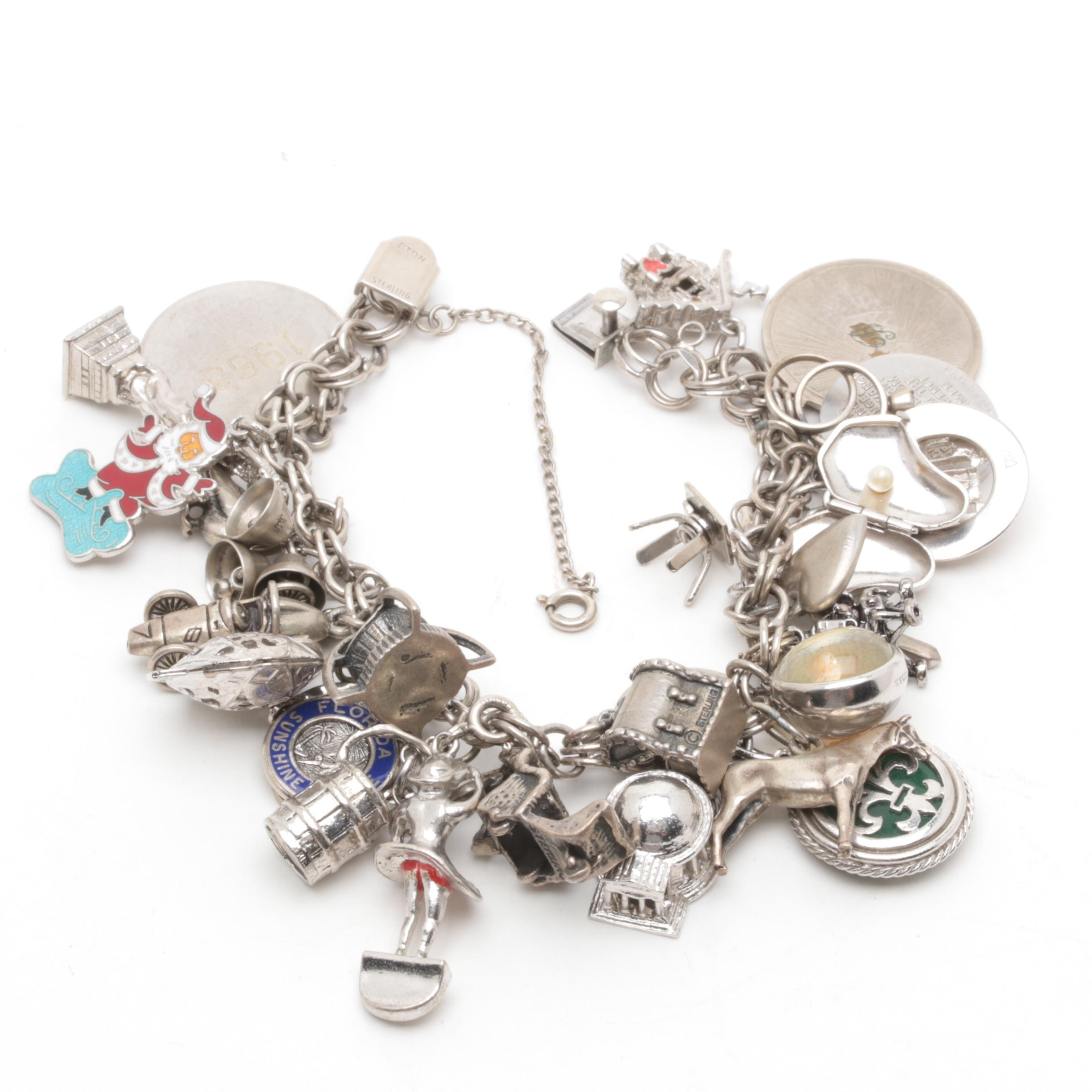 Sterling Silver Charm Bracelet Including Enamel, Glass, and Imitation Pearl