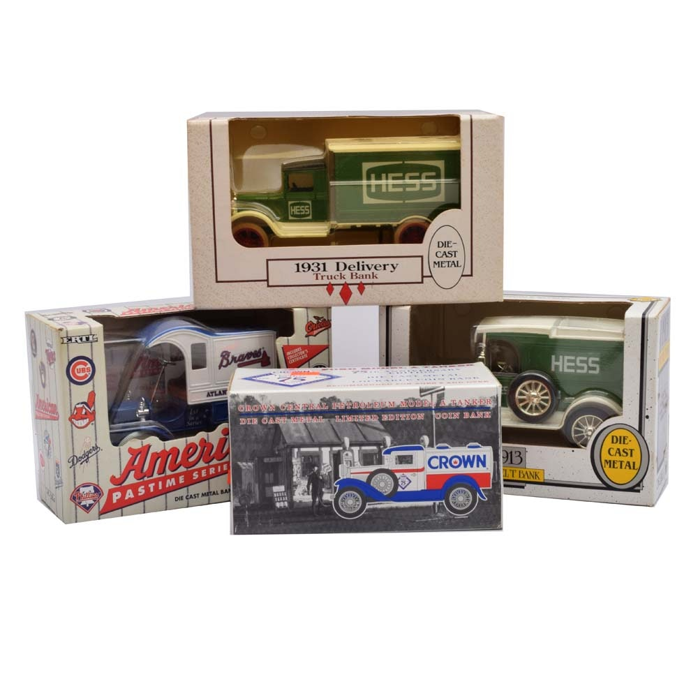A Collection of Four Die Cast Metal Banks