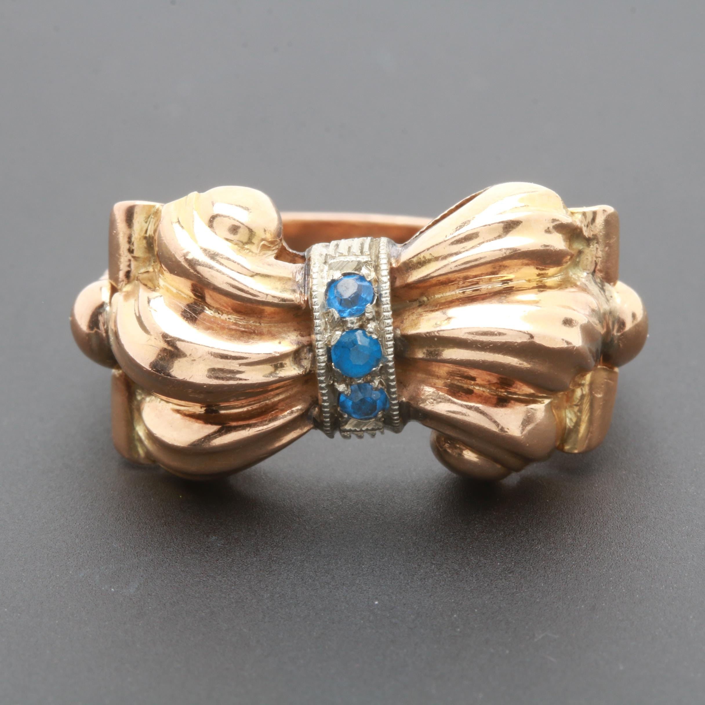 Retro Circa 1940s 18K Yellow and White Gold Synthetic Blue Spinel Bow Ring