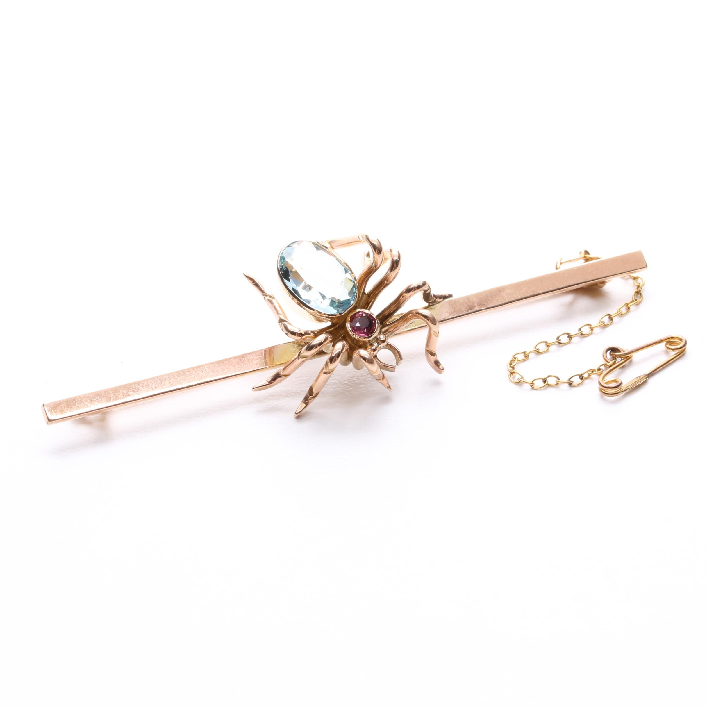 9K Yellow Gold Blue Topaz and Ruby Spider Brooch