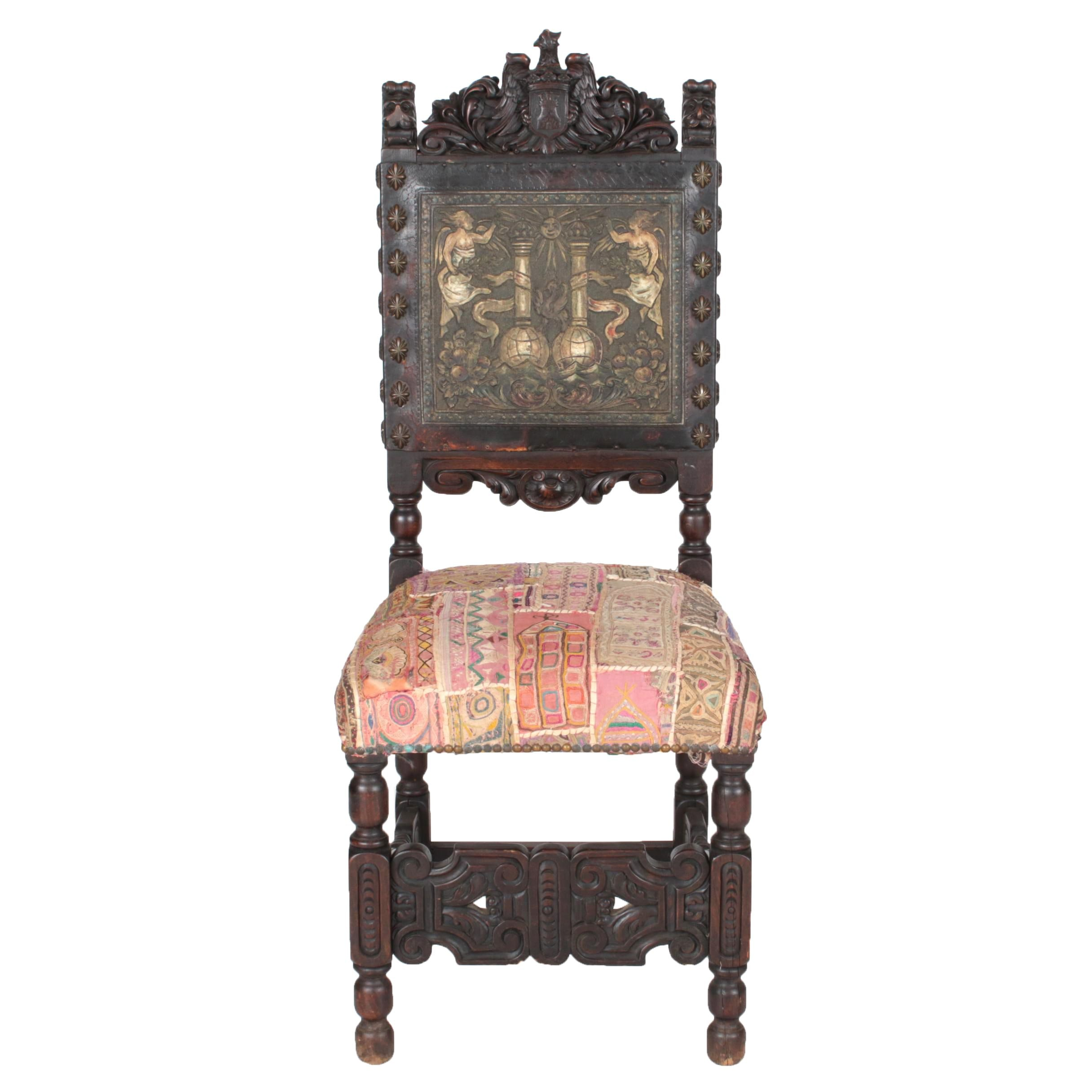 Early 20th Century Flemish Carved Beech and Embossed Leather Armorial Chair