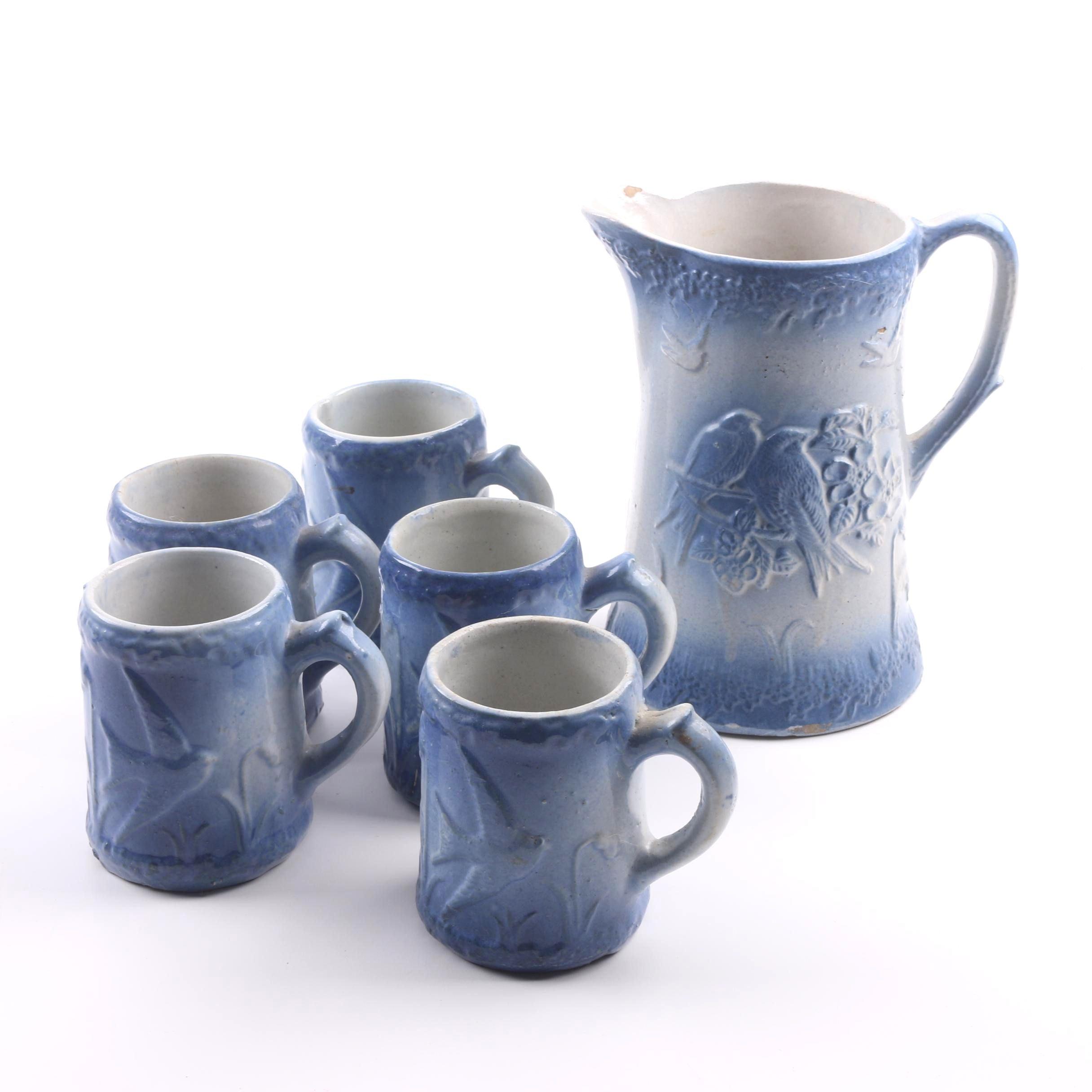 Vintage Blue Salt Glaze Stoneware Pitcher and Mugs with Bird and Floral Motif