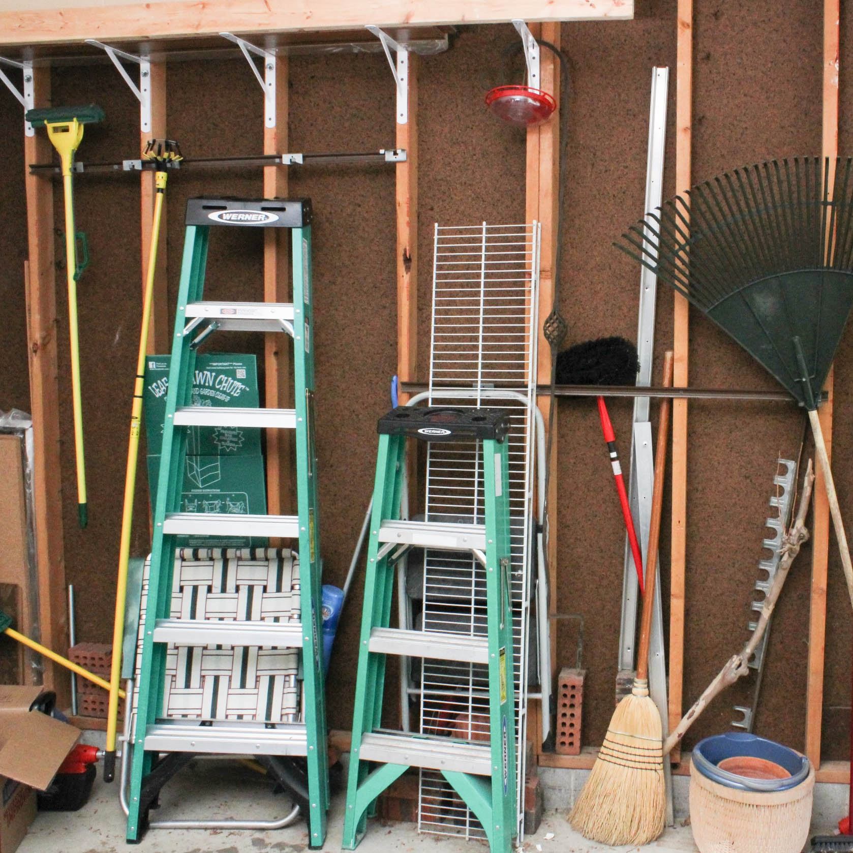 Collection of Yard Tools Featuring Werner Ladders