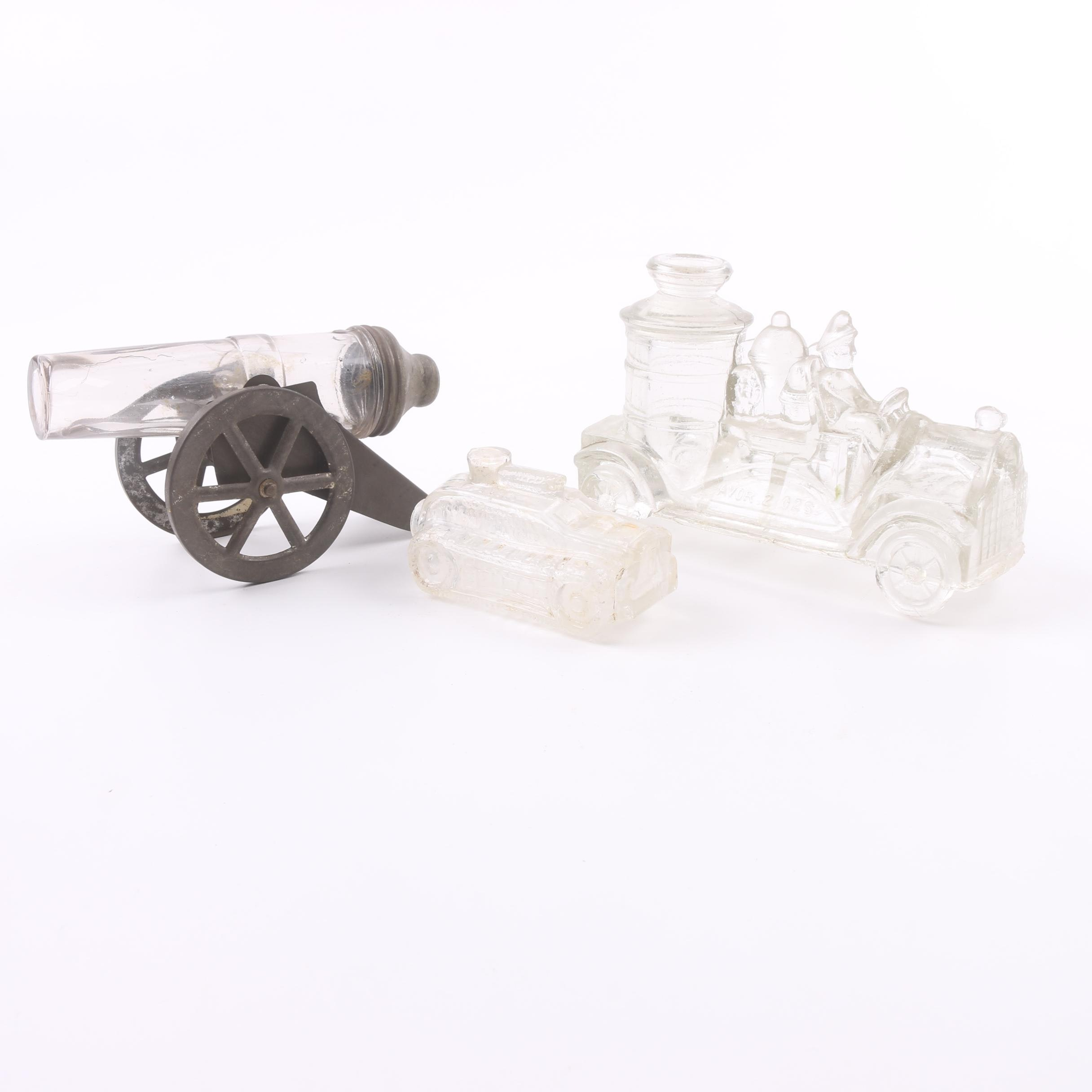 Early 20th Century Pressed Glass Figural Candy Canisters Including Cannon