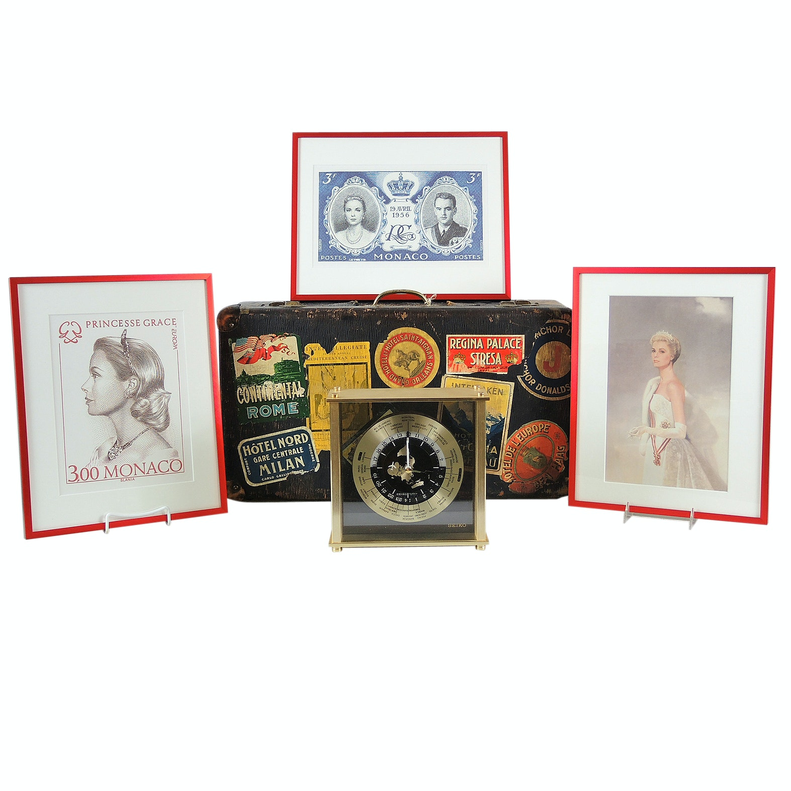 World Traveled Suitcase with Stickers, Seiko World Clock and Monaco Stamp Prints