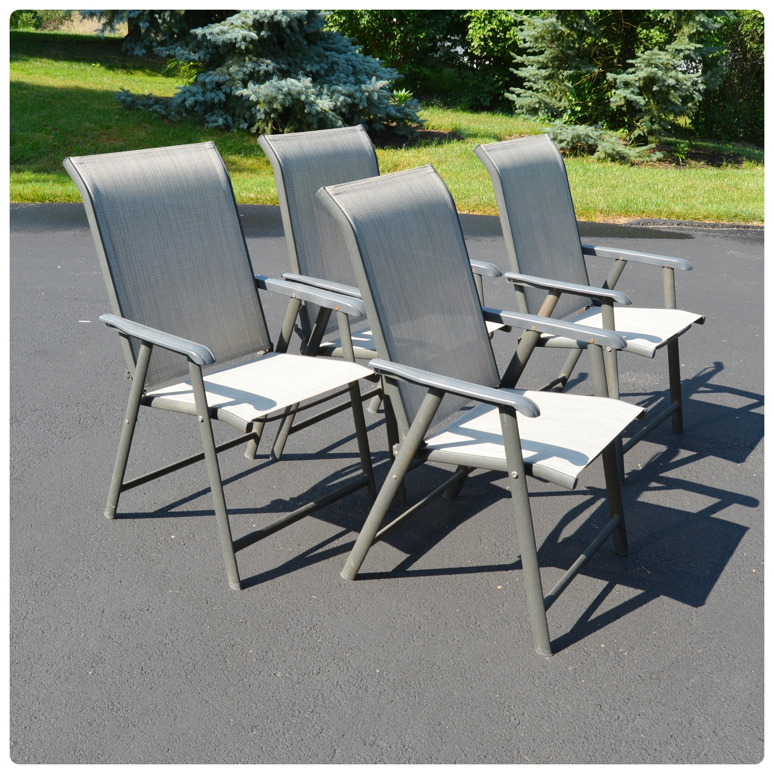 Four Folding Sling Back Patio Chairs
