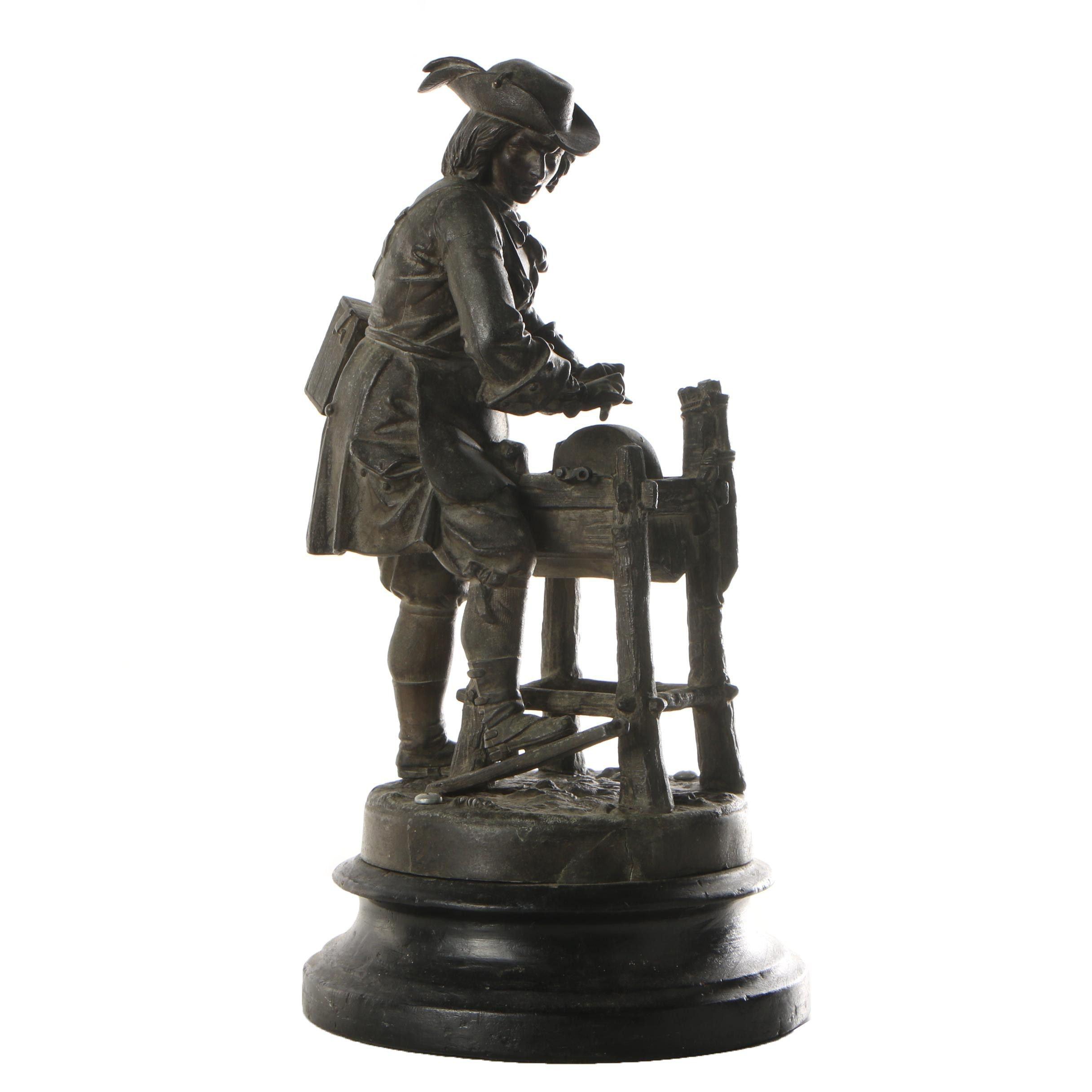 Metal Sculpture of Man Sharpening Blade