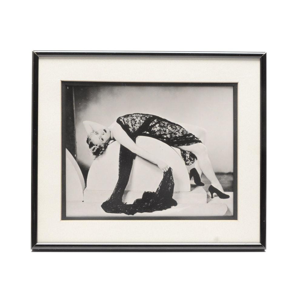 Black & White Photograph of Woman Lounging on Semi-Circle