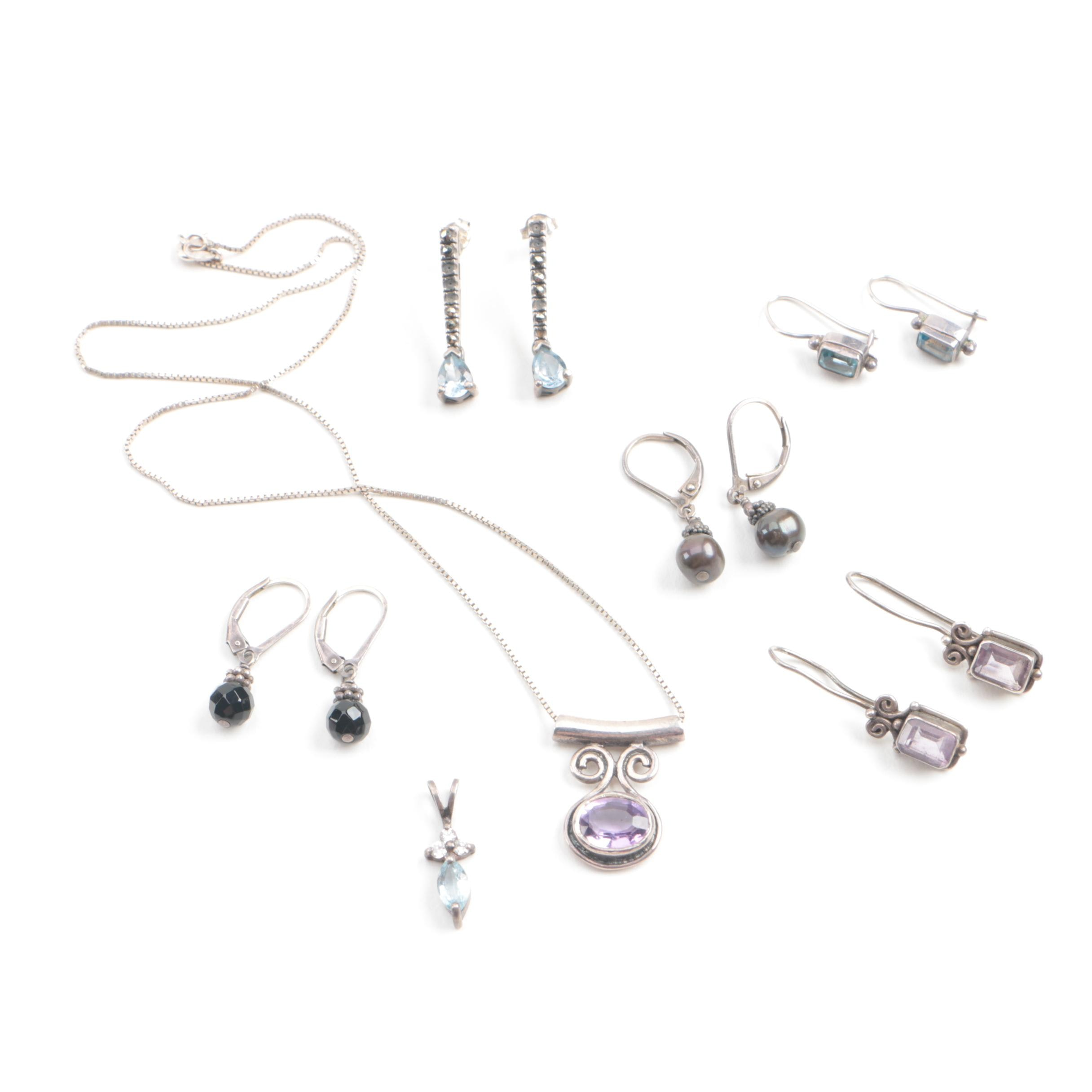 Sterling Silver Jewelry Assortment Including Amethyst, Black Onyx and Blue Topaz
