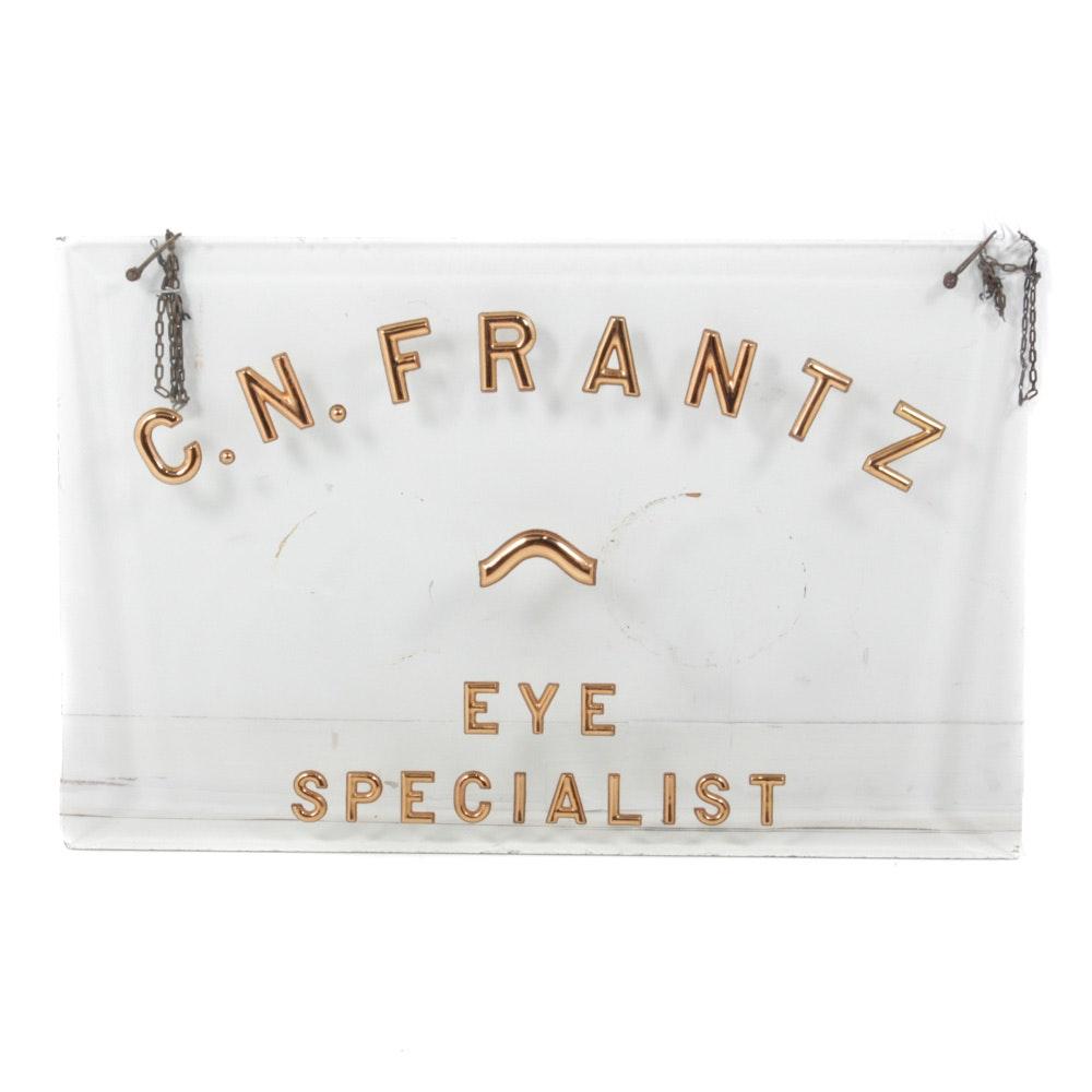 "Vintage Retail Hanging Sign ""C. N. Frantz Eye Specialist"" on Glass"