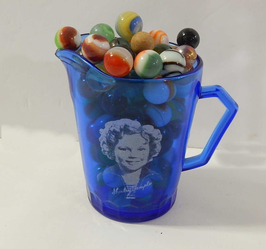 Around 100 Vintage Glass Marbles in 1940's Shirley Temple Blue Creamer