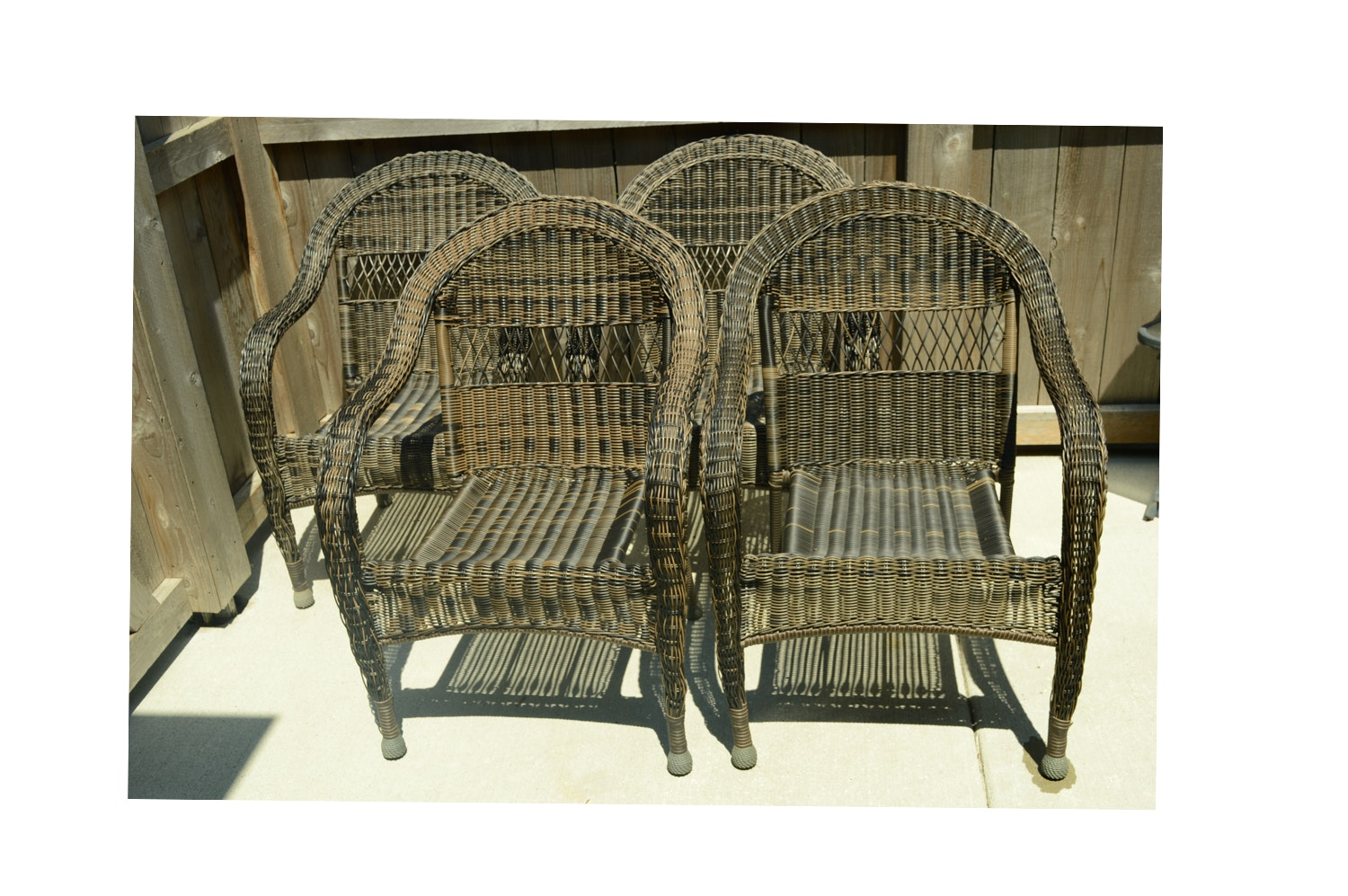 Four Wicker Woven Plastic Armchairs