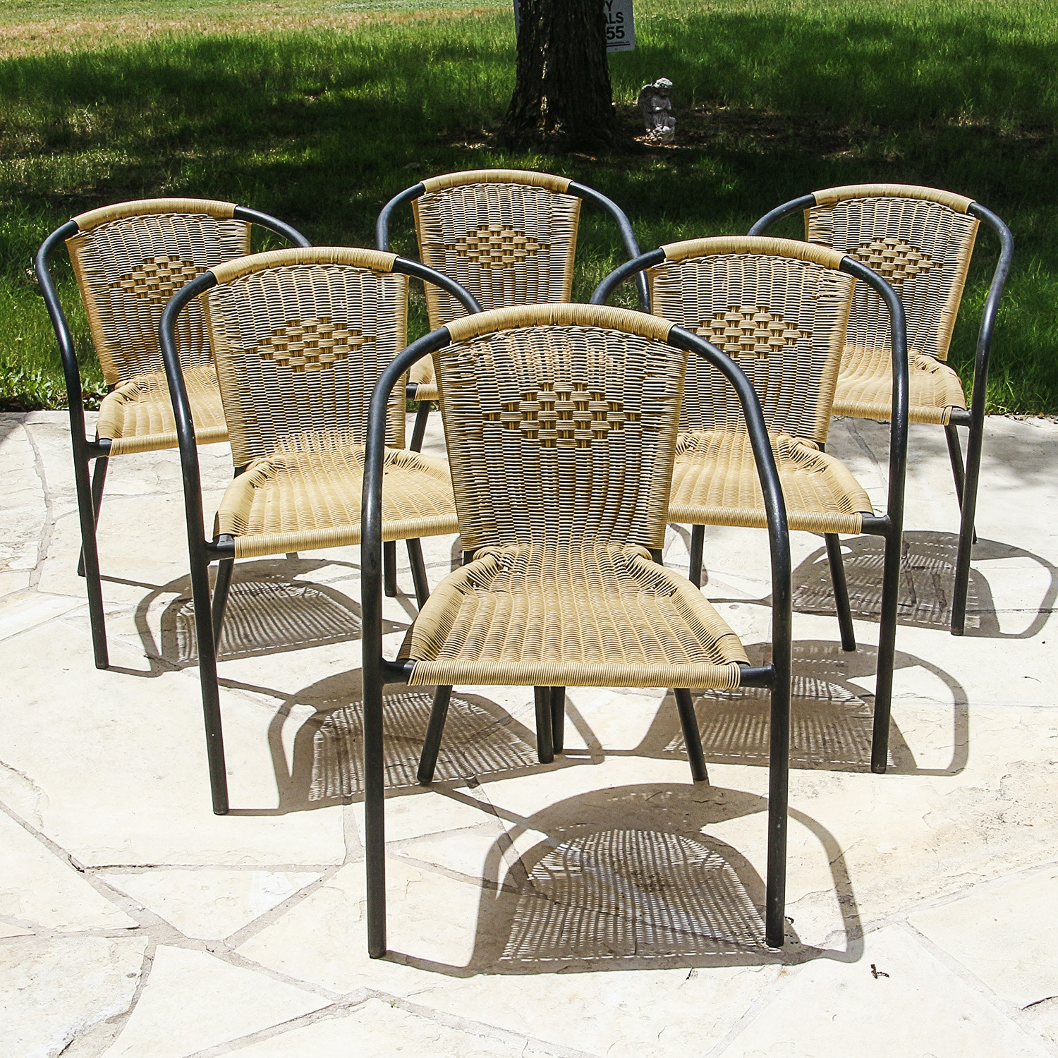 Six Metal and Wicker Woven Plastic Patio Chairs