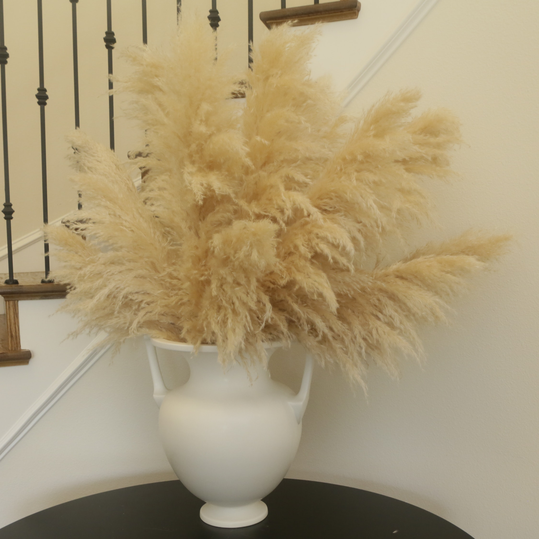Artificial Pampas Grass Plumes in White Urn Vase