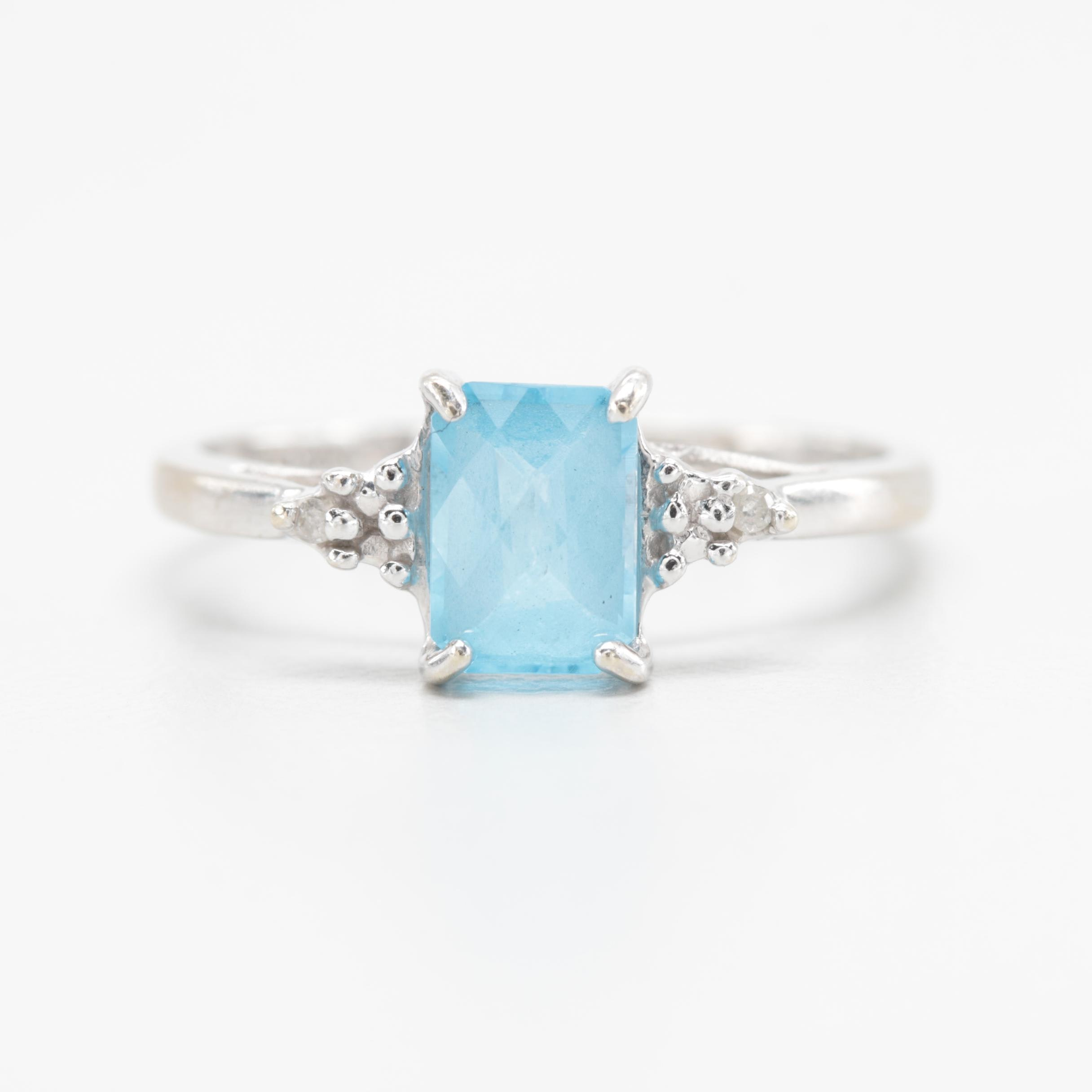 10K White Gold Blue Topaz and Diamond Ring.