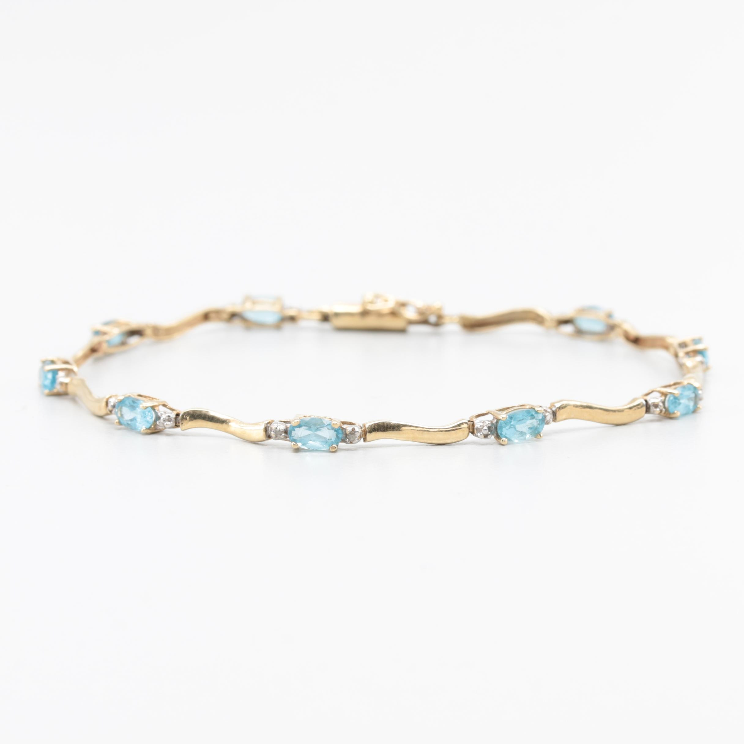 10K Yellow Gold Blue Topaz and Diamond Bracelet with White Gold Accents