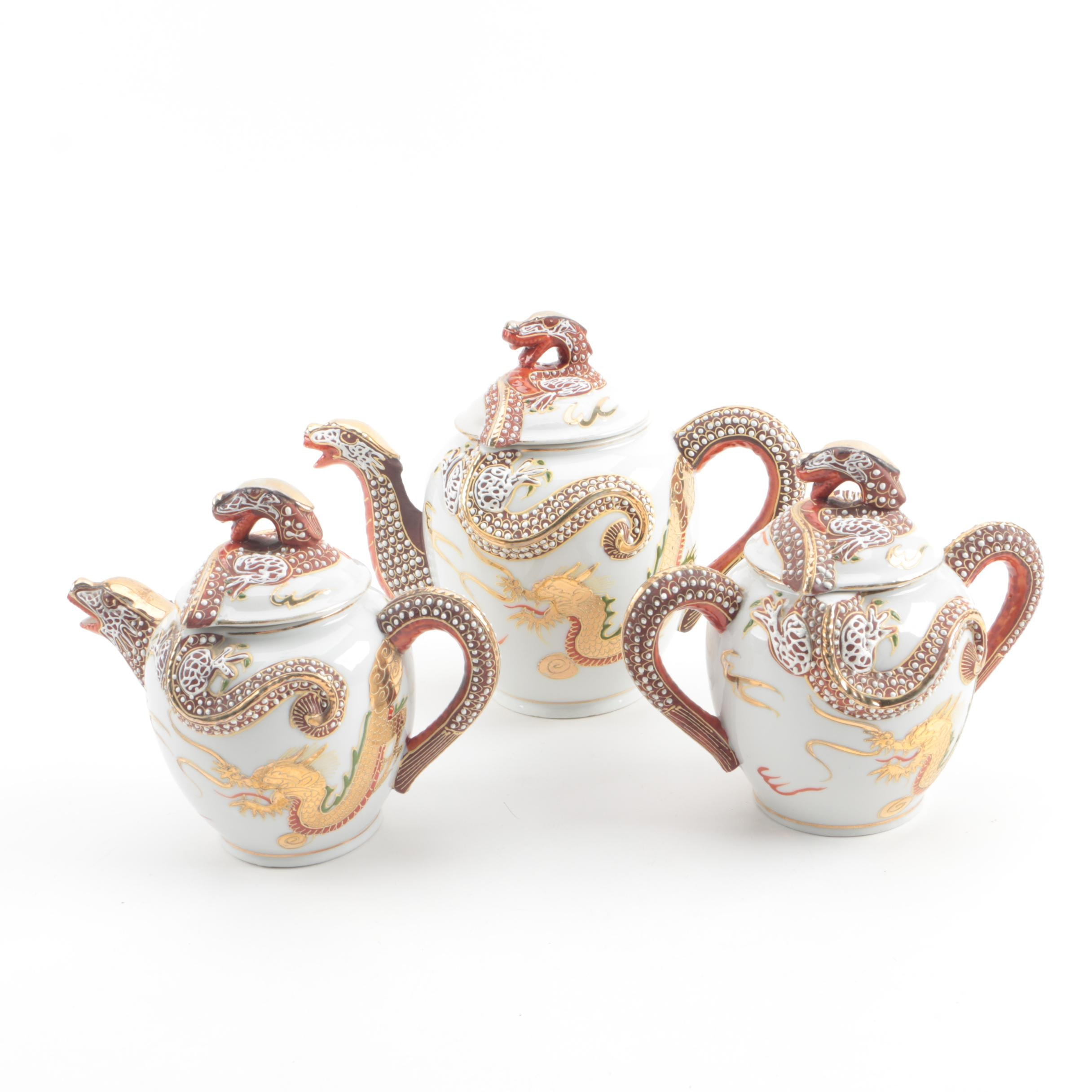 Japanese Dragon Ware Moriage Porcelain Teapot, Sugar Bowl and Creamer