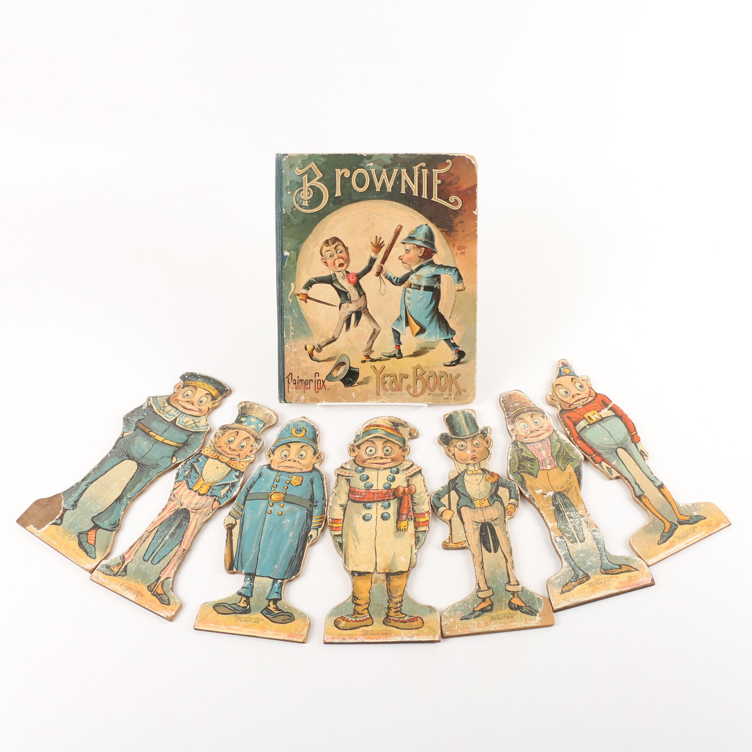 "1895 ""Brownie Year Book"" with Wooden Figurines"