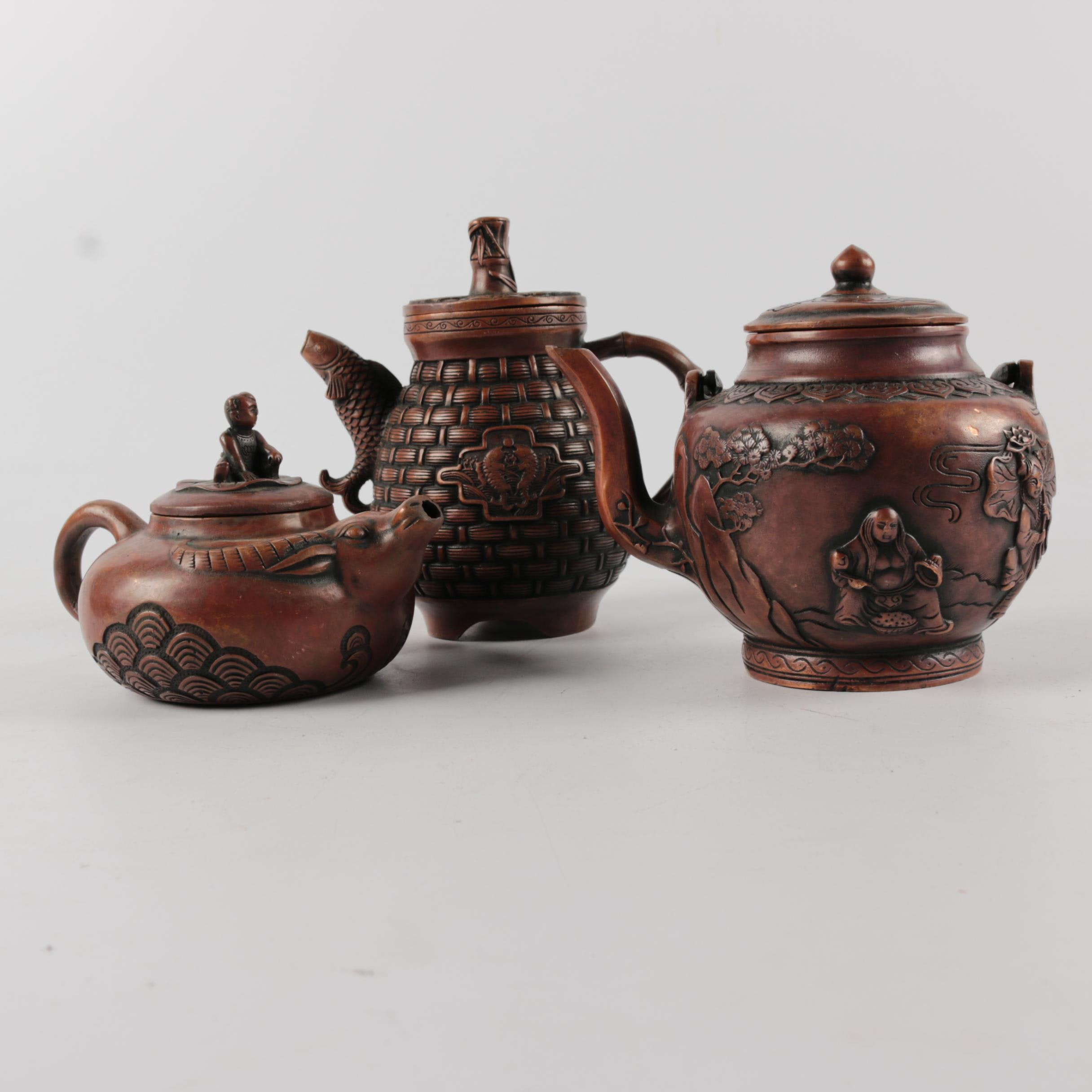 Chinese Bronze Finished Metal Teapots with Embossed Figurative Ornamentation