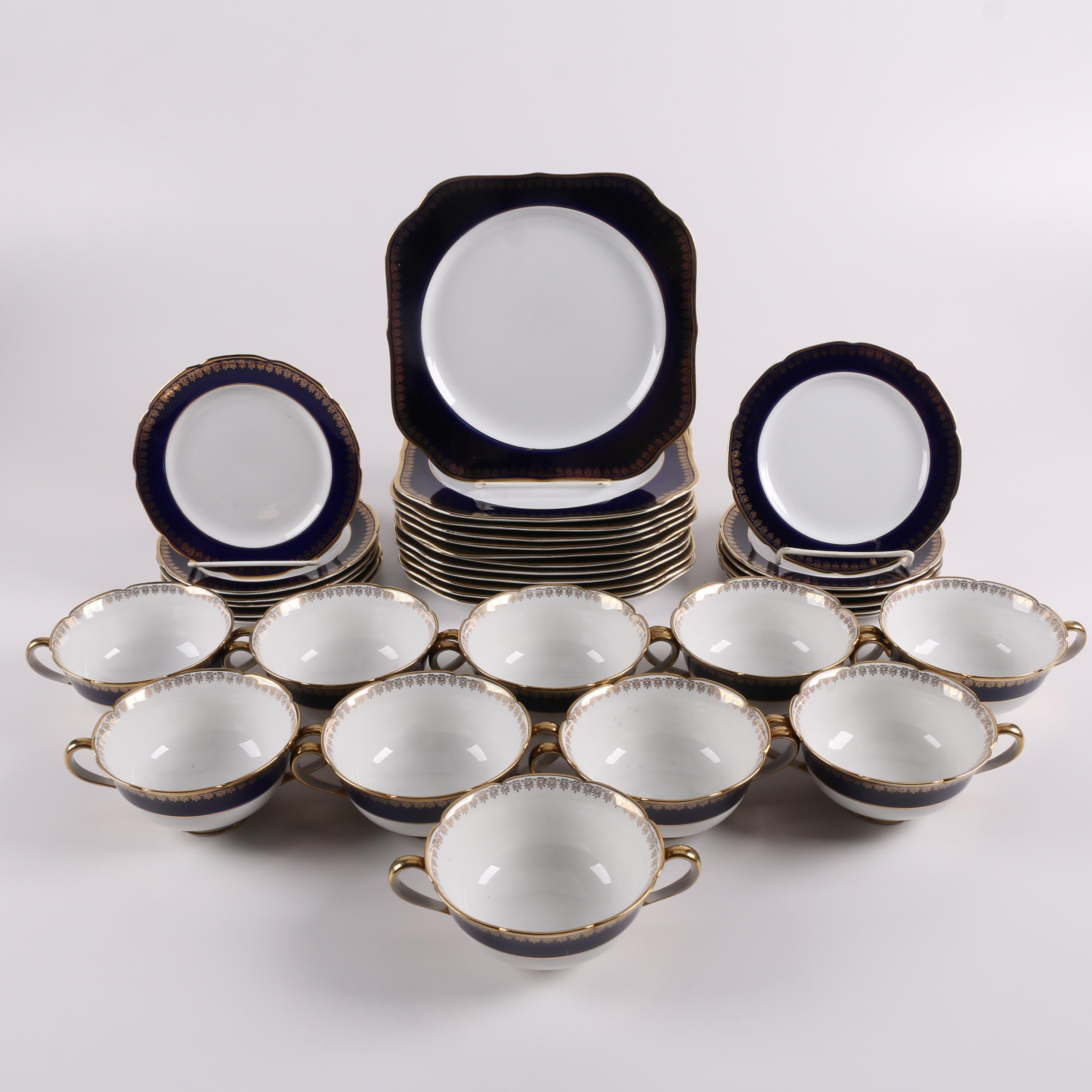 Japanese Kokura Ware Porcelain Plates and Cream Soup Bowls