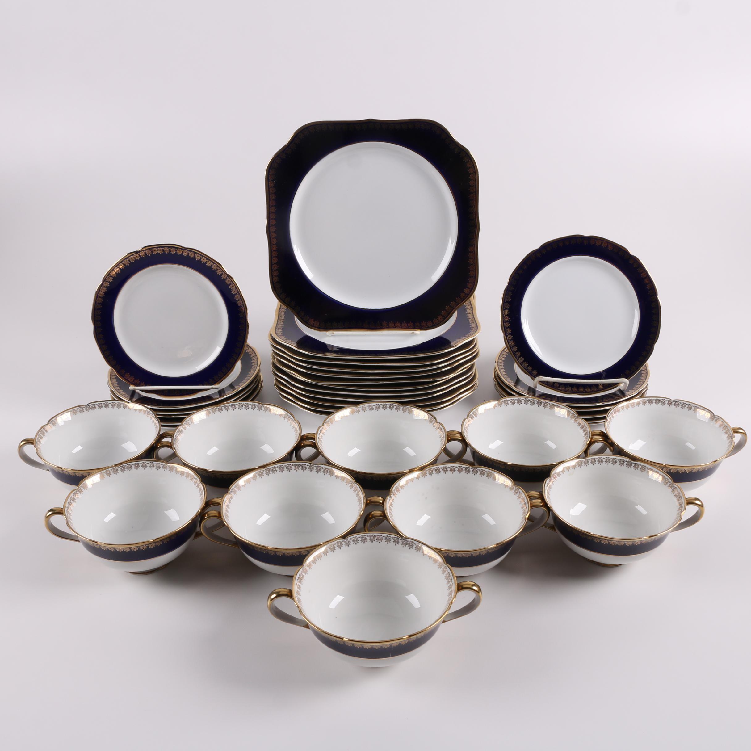 Japanese Kokura Ware Porcelain Plates and Cream Soup Bowls