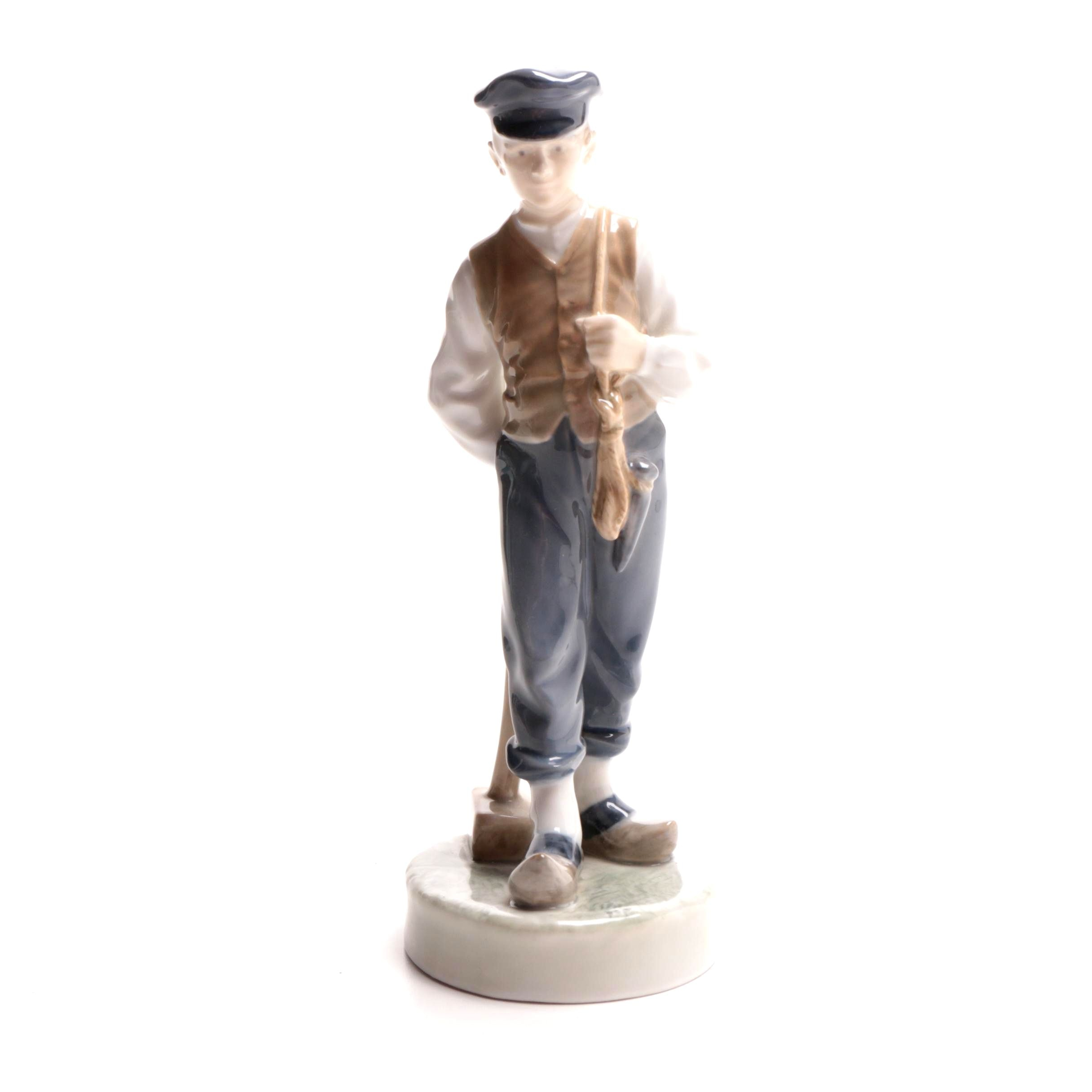 "Royal Copenhagen Hand-Painted ""Farmer Boy with Hammer"" Porcelain Figurine"