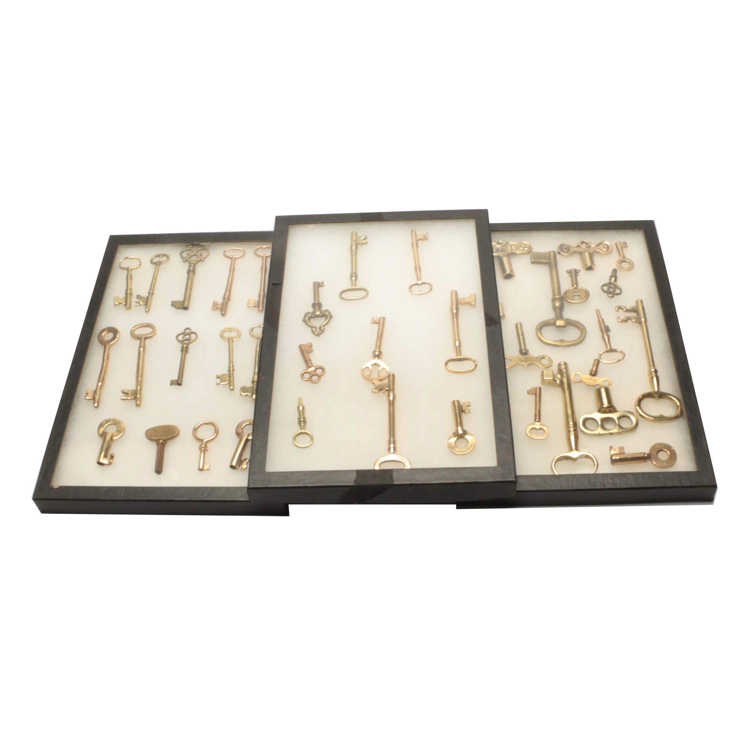 Gold Tone and Brass Key Assortment in Display Cases