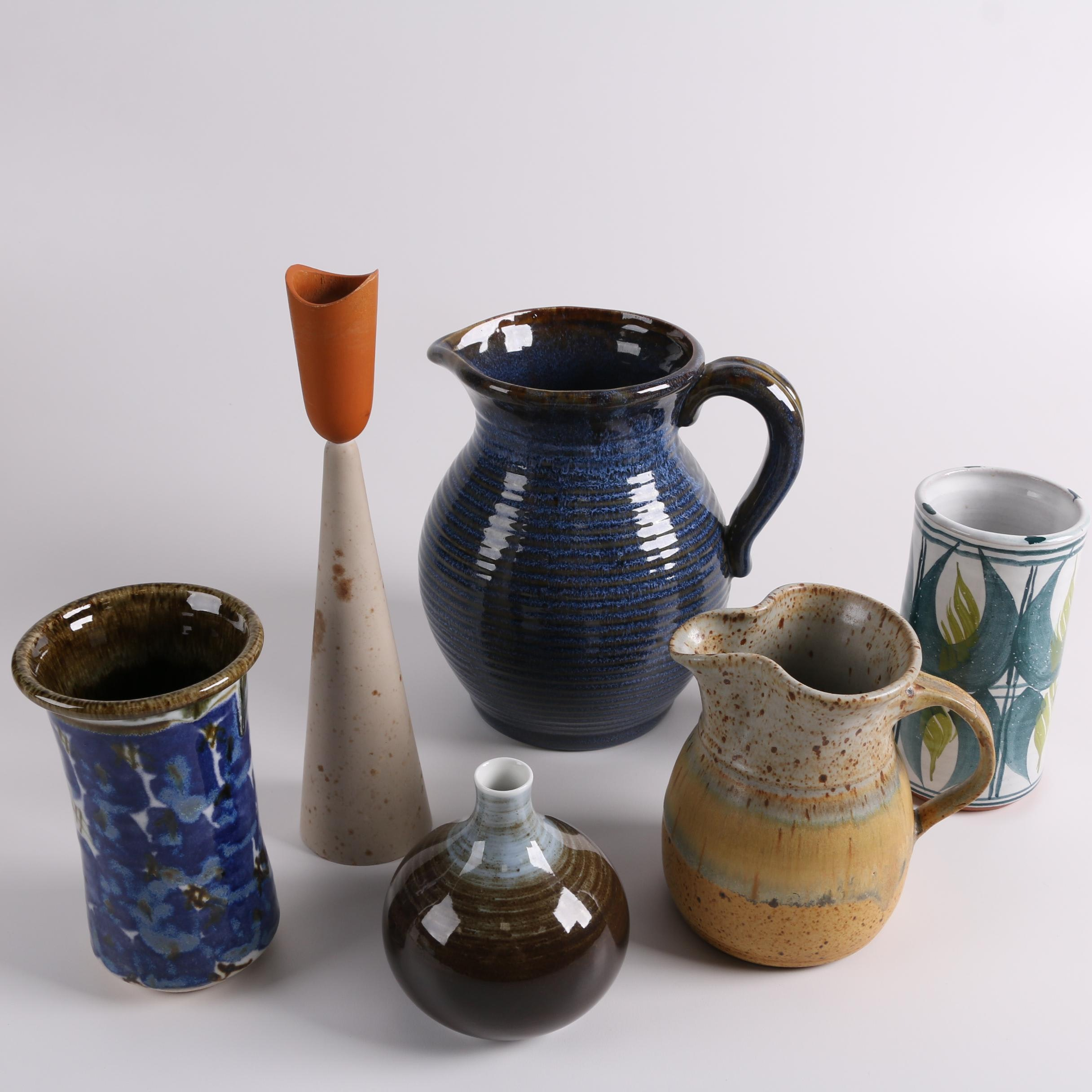 Stoneware and Ceramic Pitchers, Vases, and Candlestick