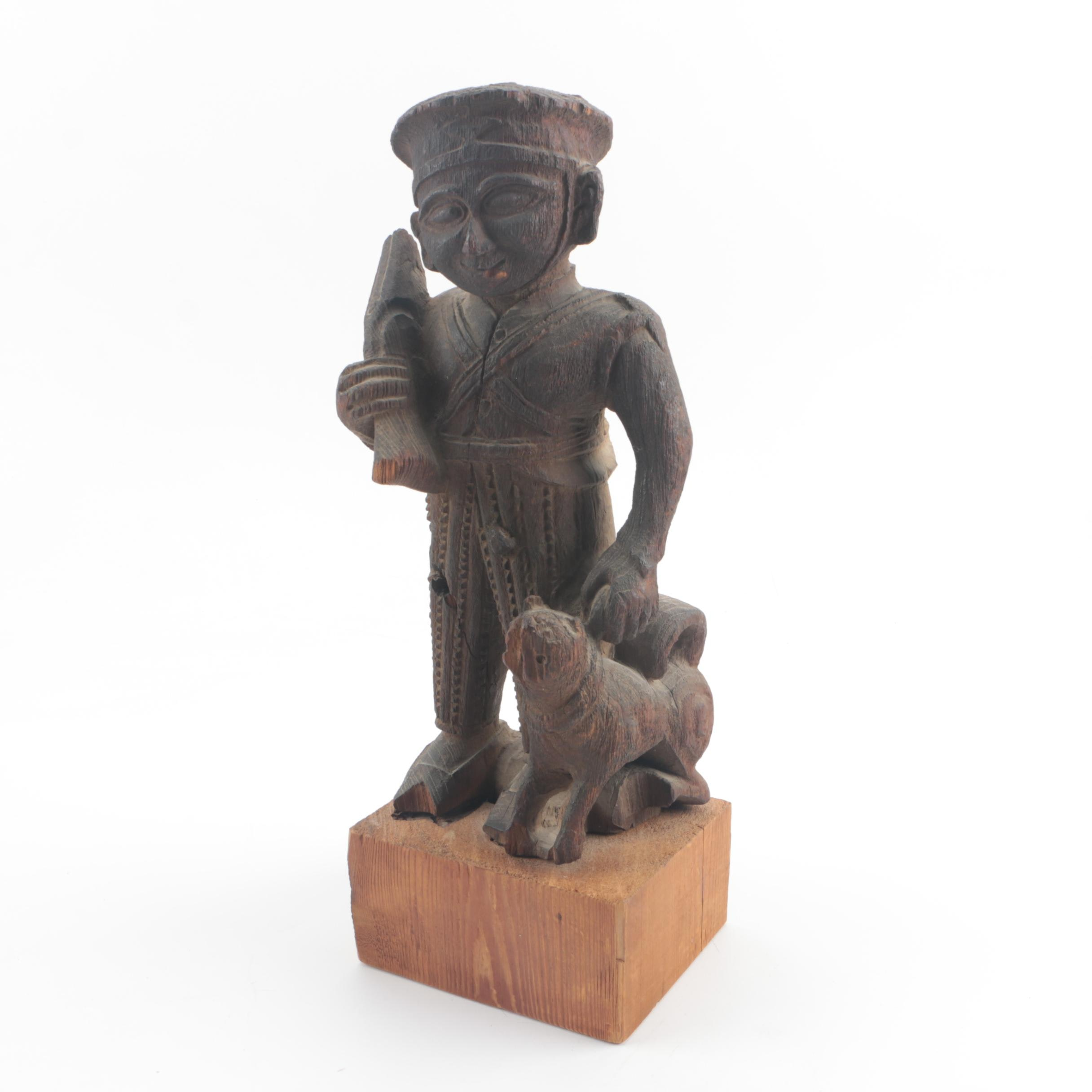 Wood Carving of Soldier and Dog