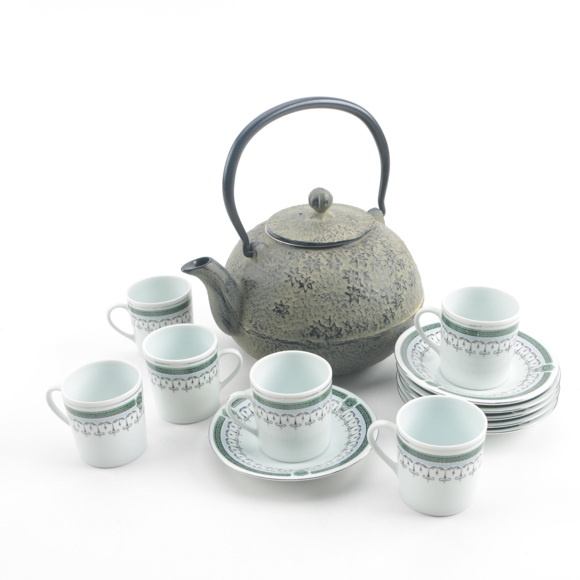 Chinese Cast Iron Teapot with Porcelain Flat Cups and Saucers