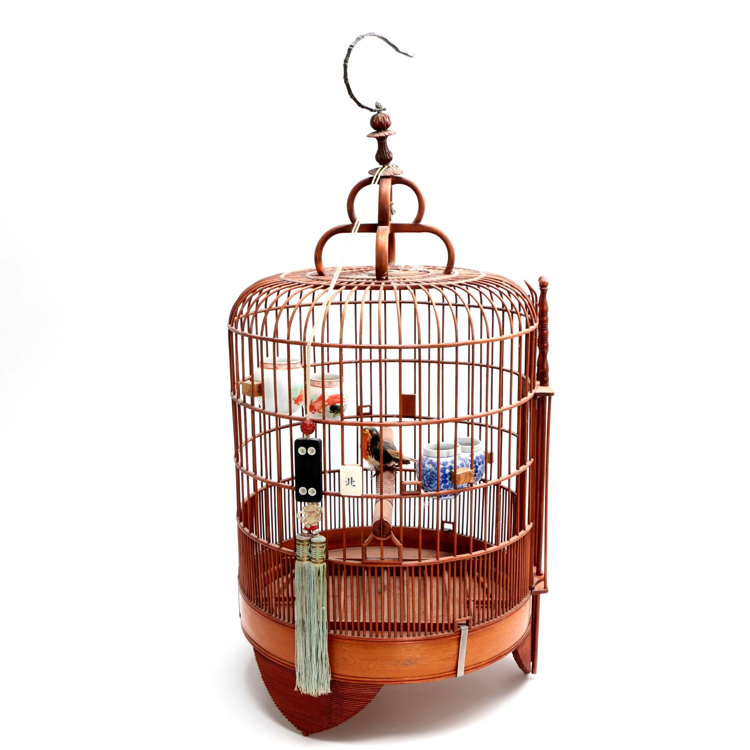 Chinese Bird Cage with Porcelain Accent Vessels