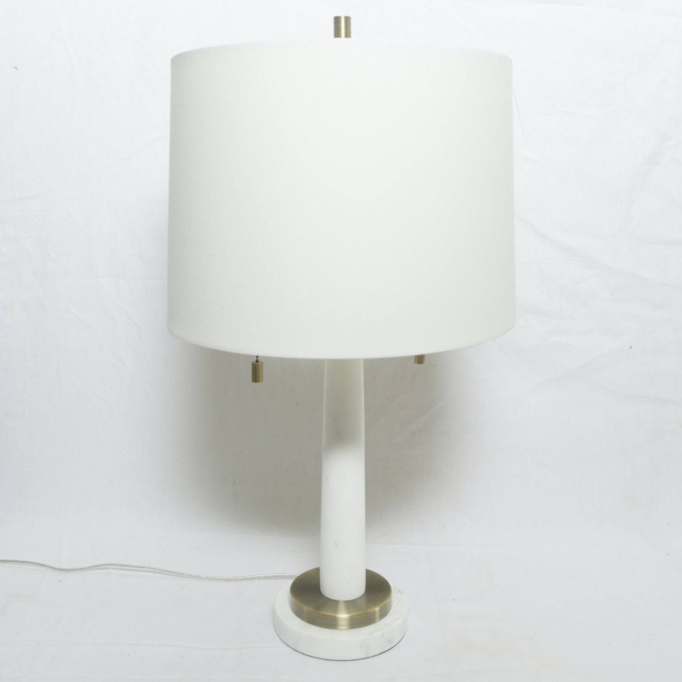 White Cylindrical Two-Light Table Lamp with Gold Tone Finial and Accented Base
