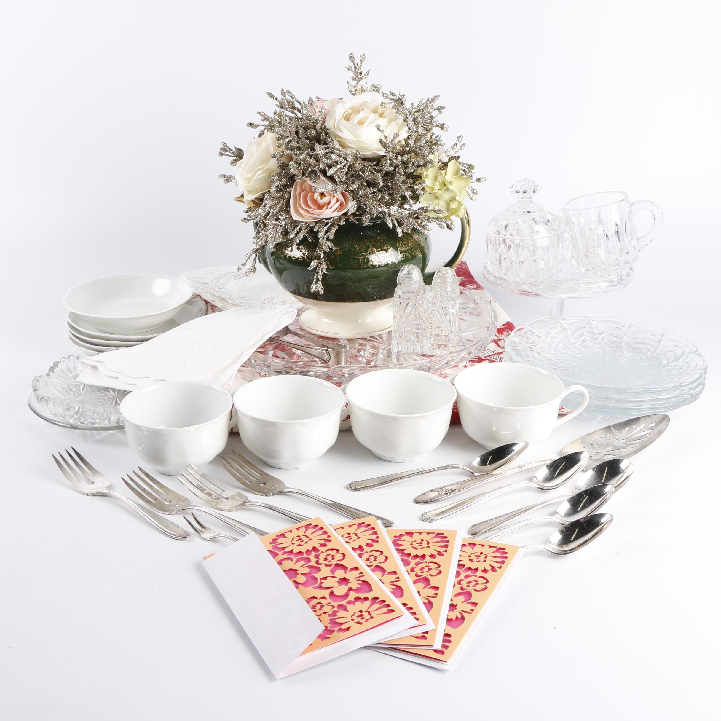 Ceramic and Glass Tableware with Flatware and Floral Centerpiece