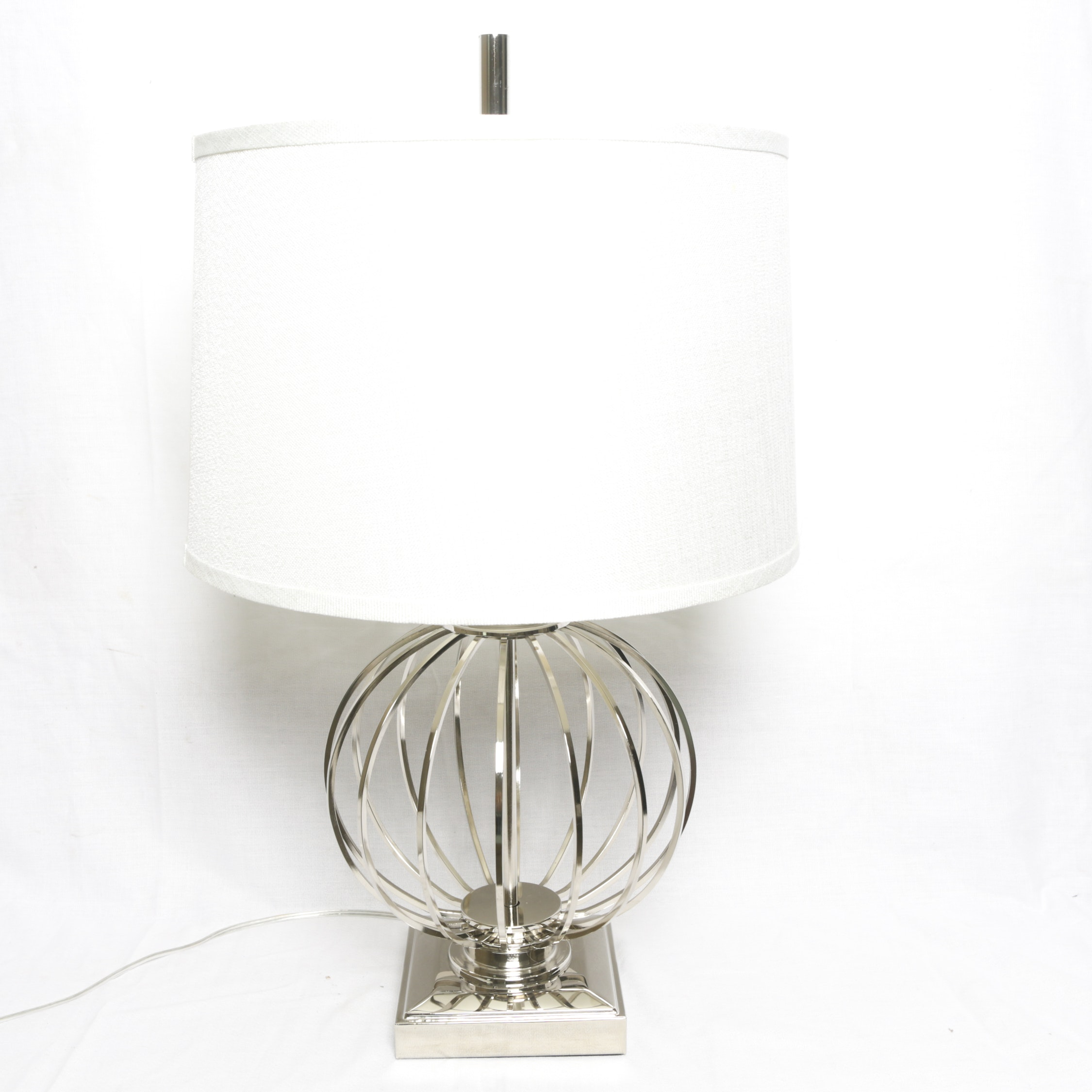 Silver Tone Metal Caged Ball Table Lamp with White Fabric Covered Drum Shade