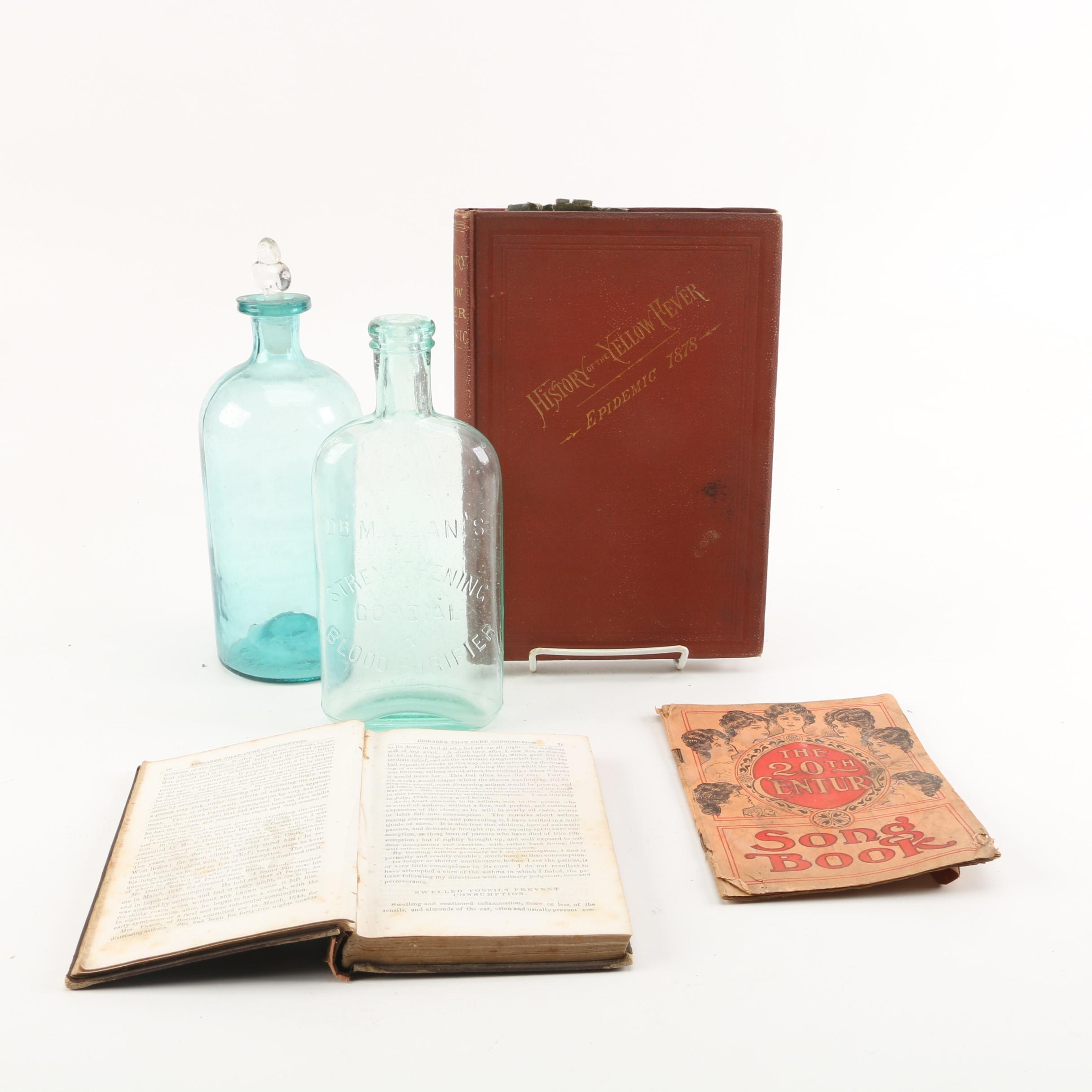 Vintage Glass Bottles and Antique Books