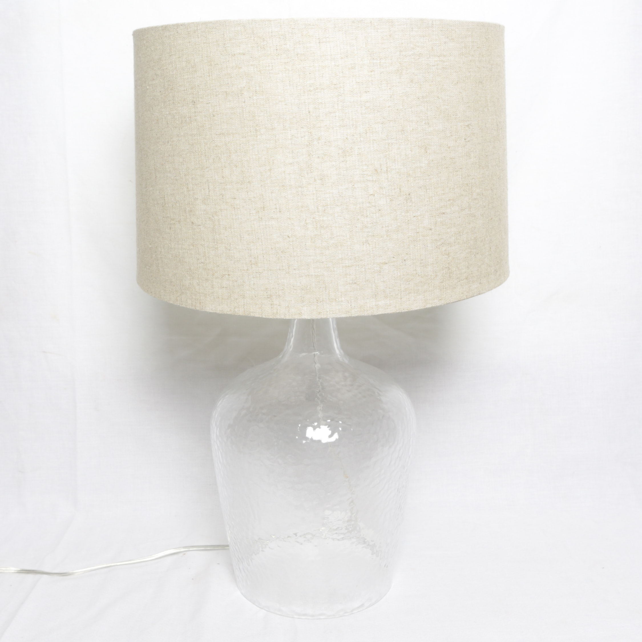 Clear Textured Glass Table Lamp with Tan Fabric Covered Drum Shade