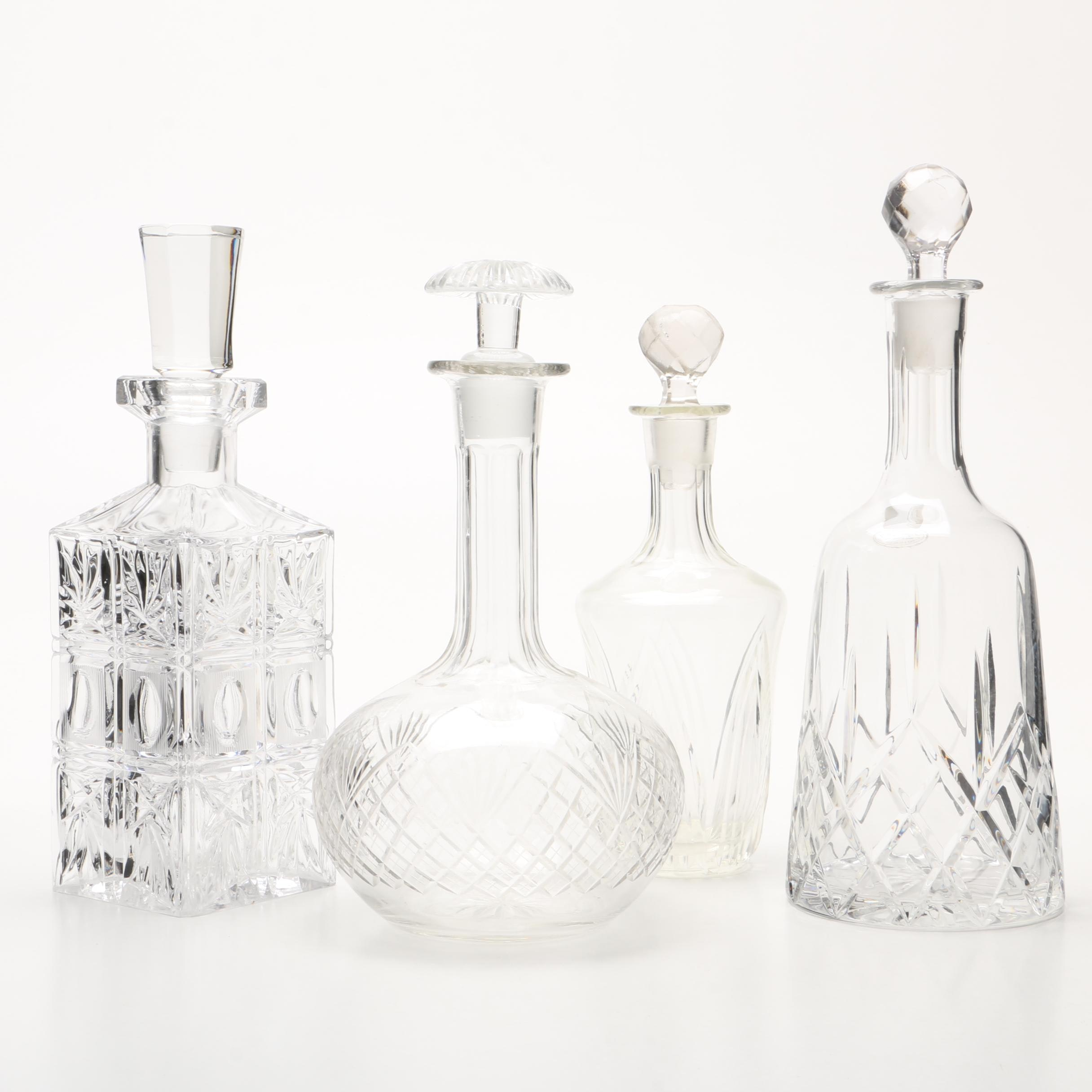 Four Cut and Molded Glass Decanters and Stoppers, 20th Century