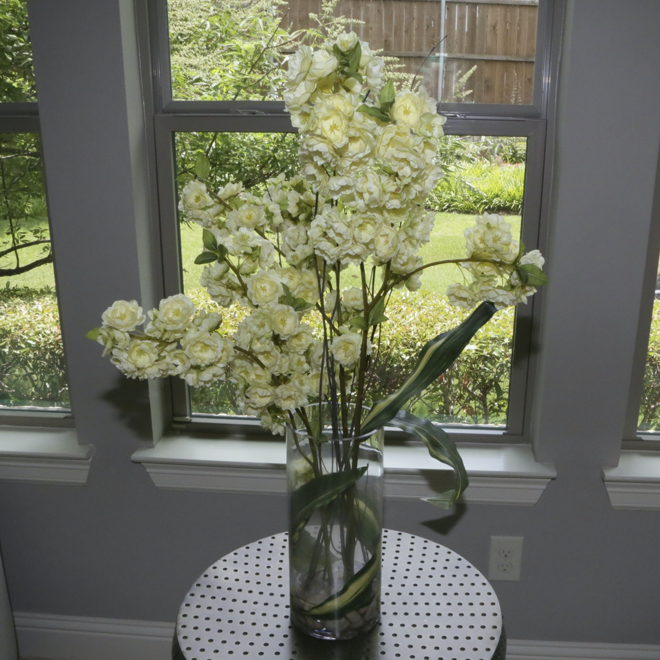 Cylindrical Glass Vase Filled with Bouquet of White Fabric Flowers
