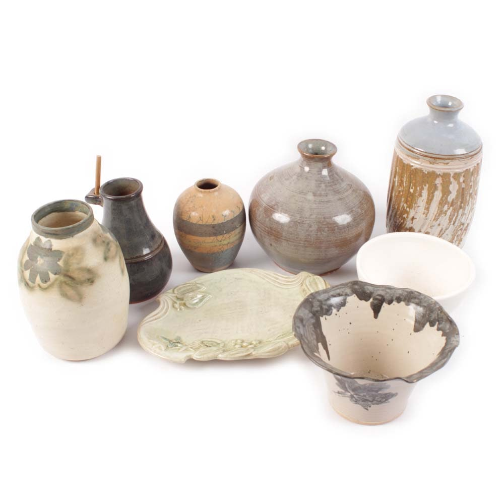 Vintage Collection of Hand Thrown Pottery Featuring Brown Pottery
