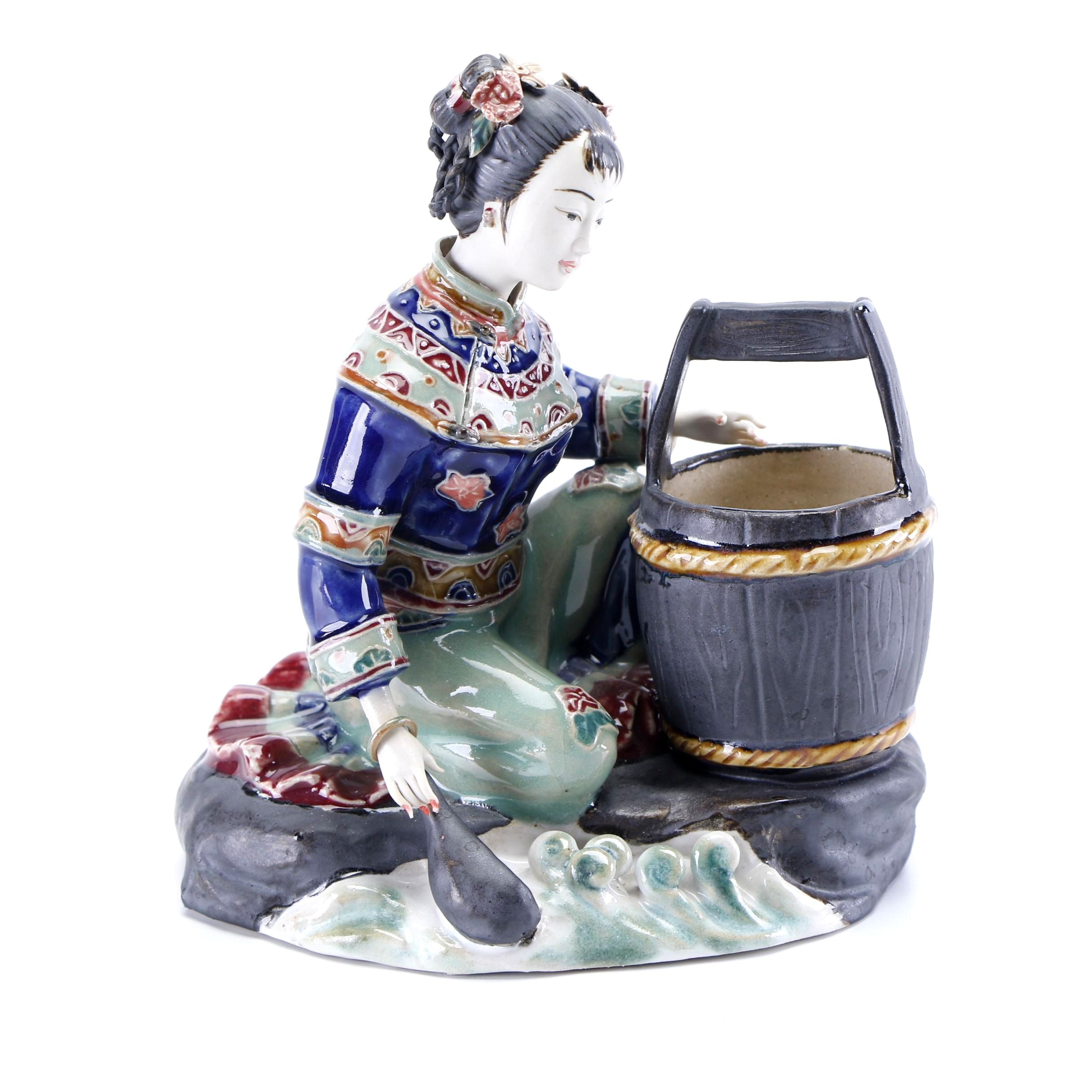 Chinese Shiwan Style Porcelain Figurine of a Woman Collecting Water