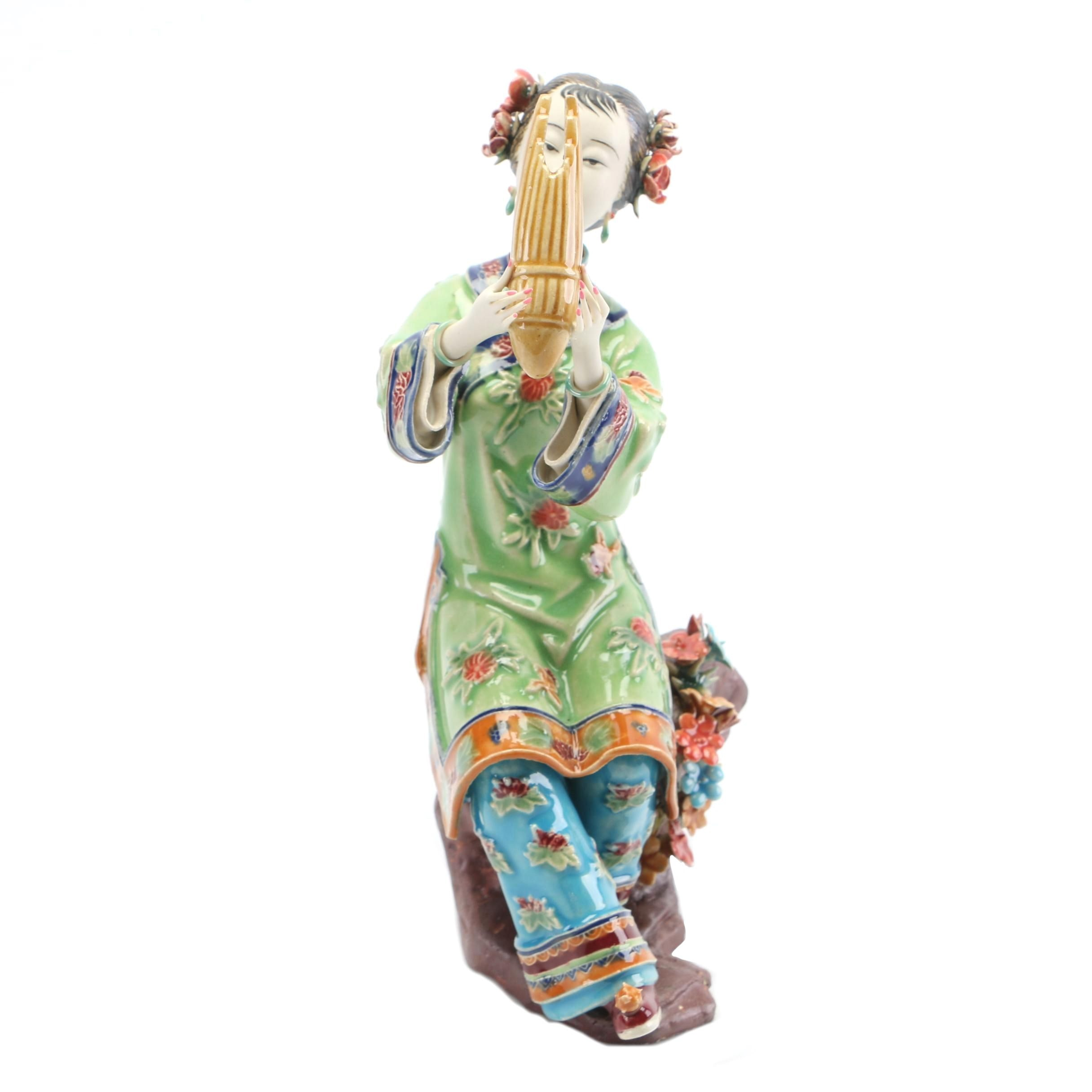 Chinese Shiwan Style Ceramic Female Playing a Reed Mouth Organ Figurine