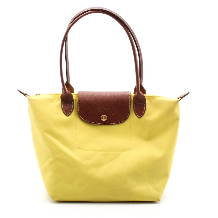 a55a33545e2 Longchamp Paris Le Pliage Yellow Nylon Tote Trimmed in Brown Leather ...