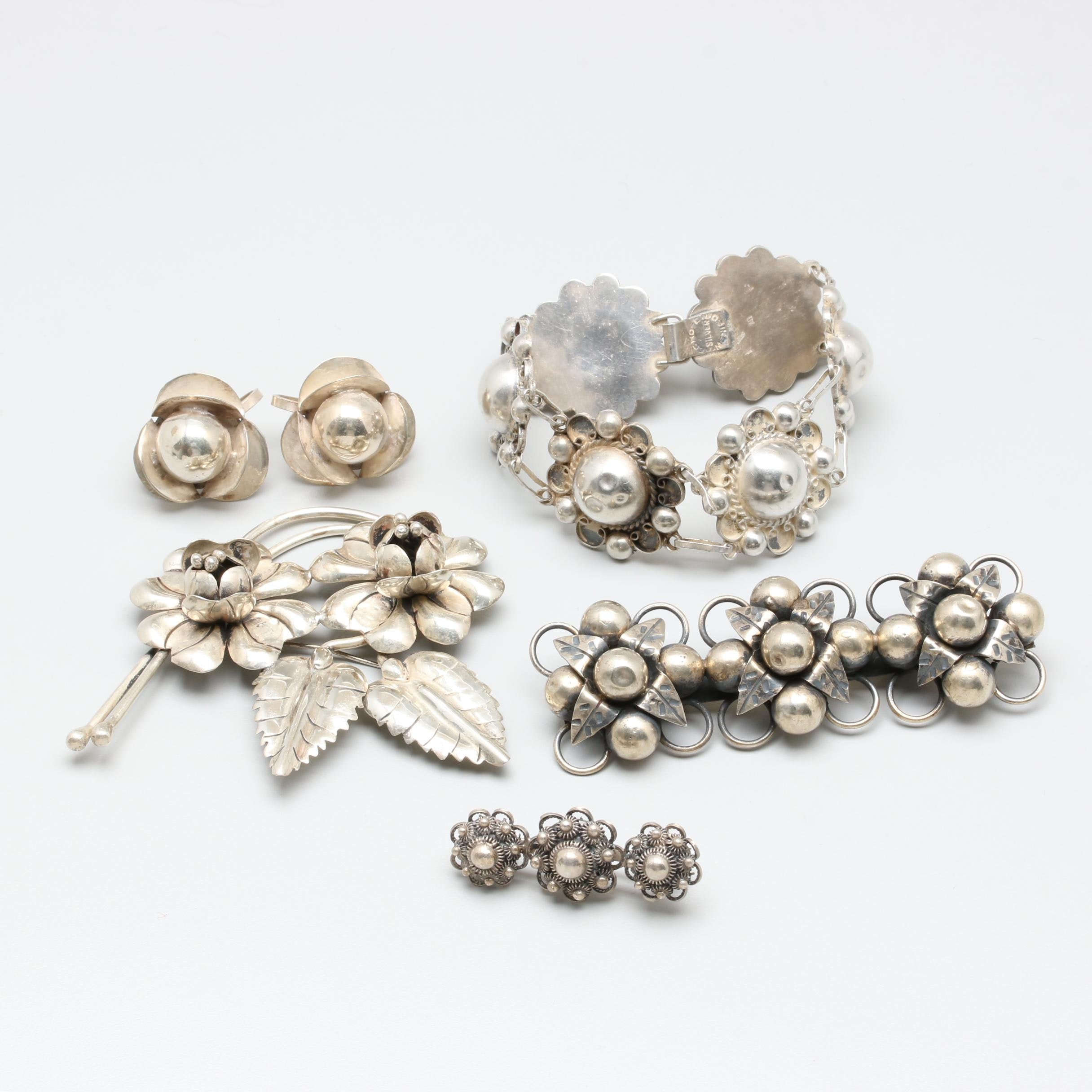 Sterling Silver Jewelry Assortment Featuring Floral Motifs