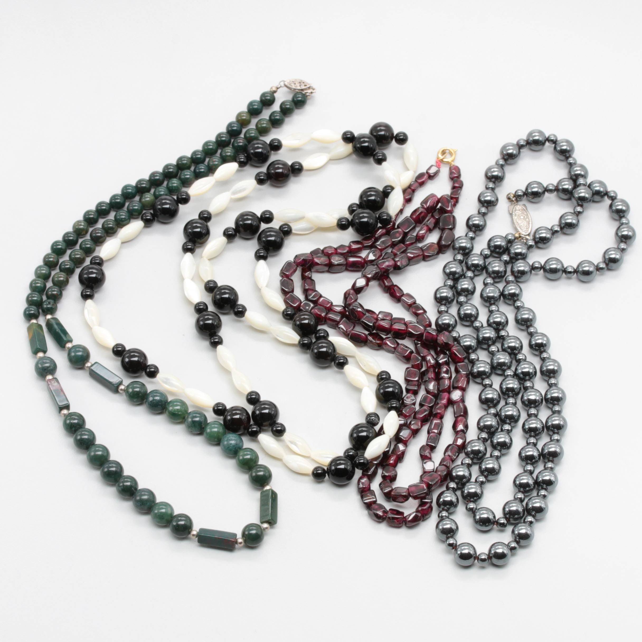 Collection of Necklaces Including Black Onyx, Moss Agate, and Mother of Pearl