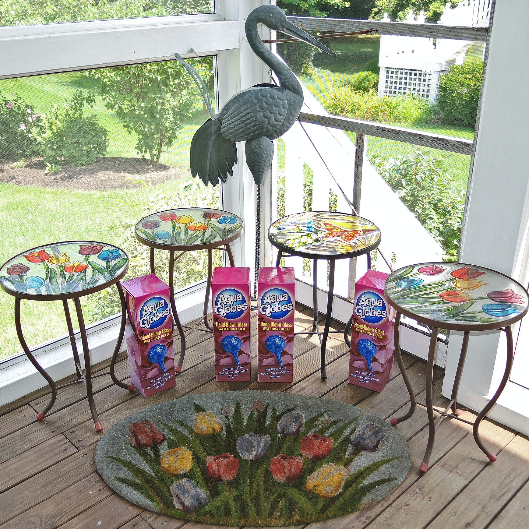 Colored Glass Patio Tables, Crane Lawn Ornament, Rug and Blown Glass Globes